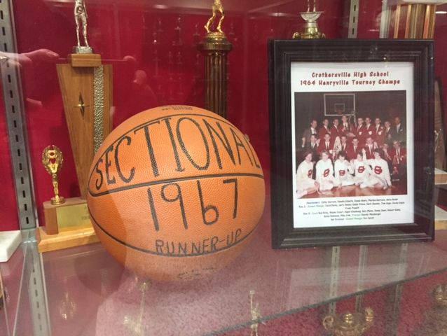 An awards display case commemorates a 1967 sectional runner-up finish.