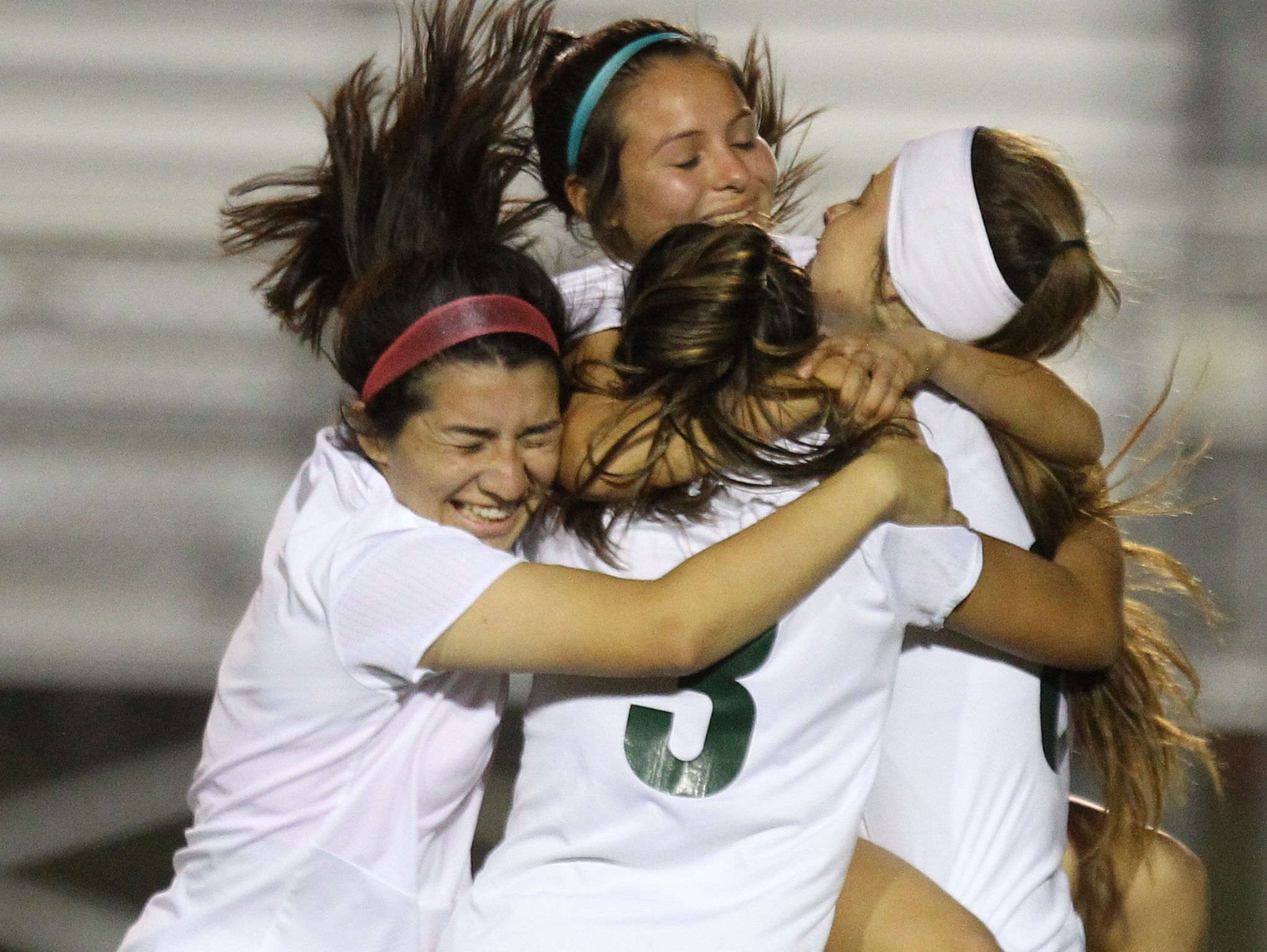 Coachella Valley High School's soccer team celebrate their second goal in the second half of their championship De Anza League against Rancho Mirage High School in Thermal on February 7, 2017.