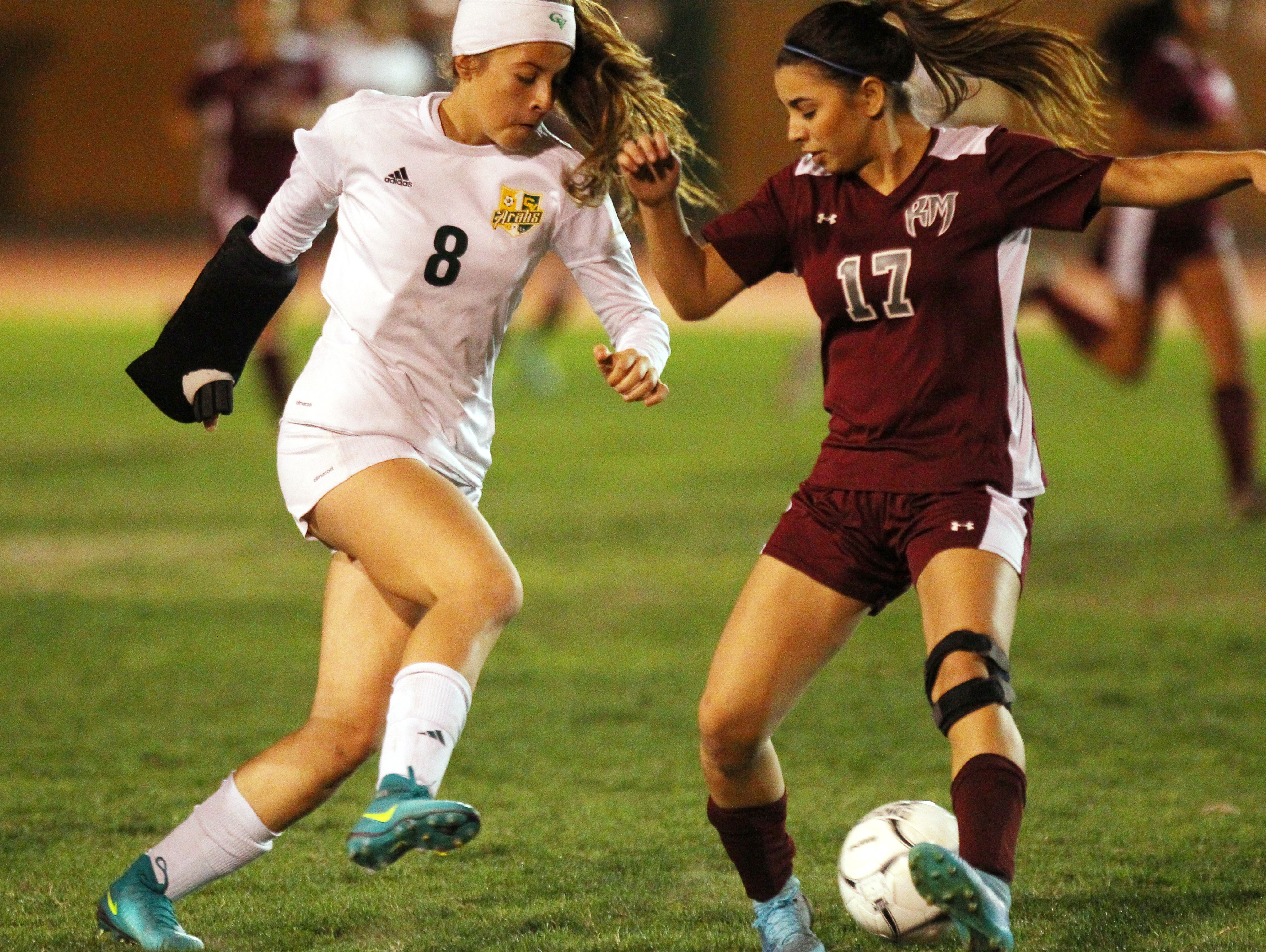 Rancho Mirage's Daniela Jimenez tries to stop Coachella Valley High School's Miranda Torres during their championship De Anza League in Thermal on February 7, 2017. Coachella won 2-0.