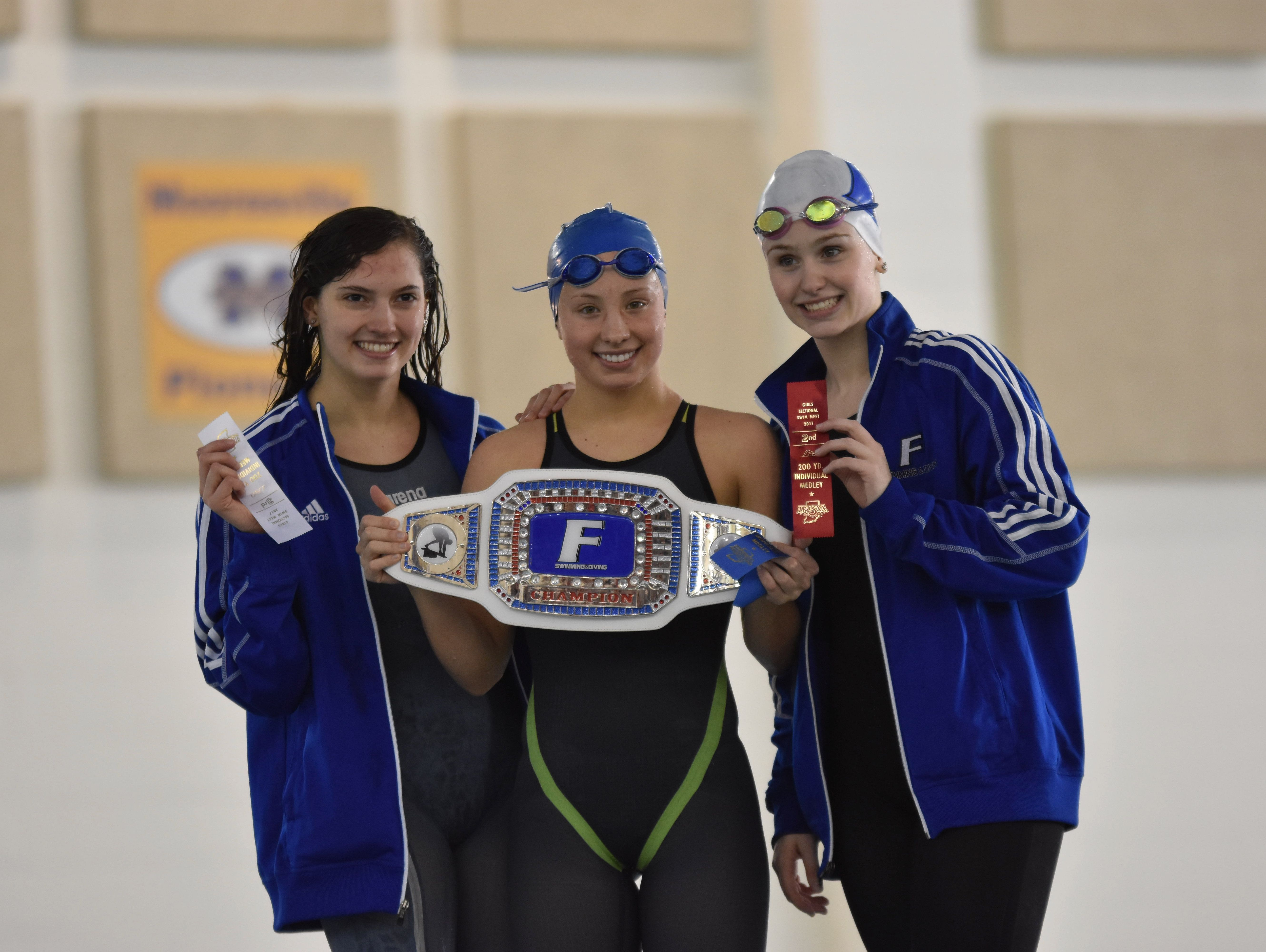 Gabby Hoffman (left, 3rd place), Ali Terrell (middle, 1st place), Anna McCahill (right, 2nd place) share the podium after the 200 IM.