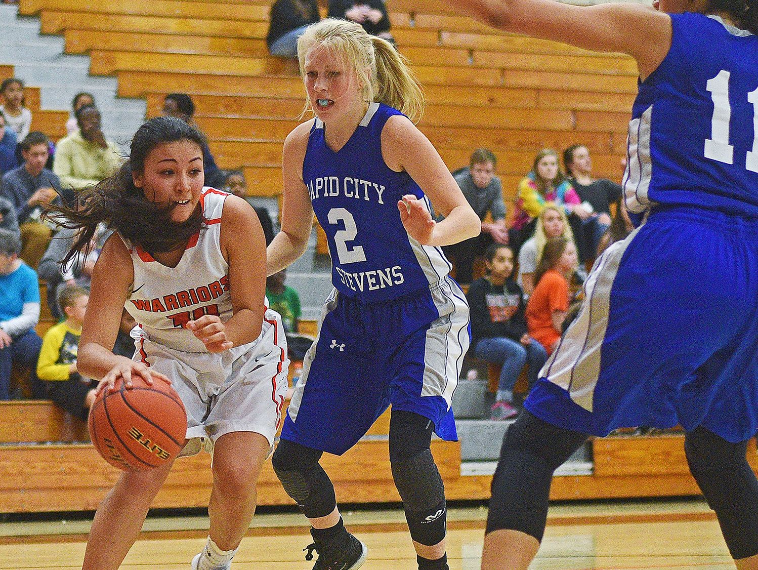 Washington's Taylor VanderVelde (30) drives past Rapid City Stevens' Ally Riddle (2) during a game Friday, Feb. 10, 2017, at Washington High School in Sioux Falls.