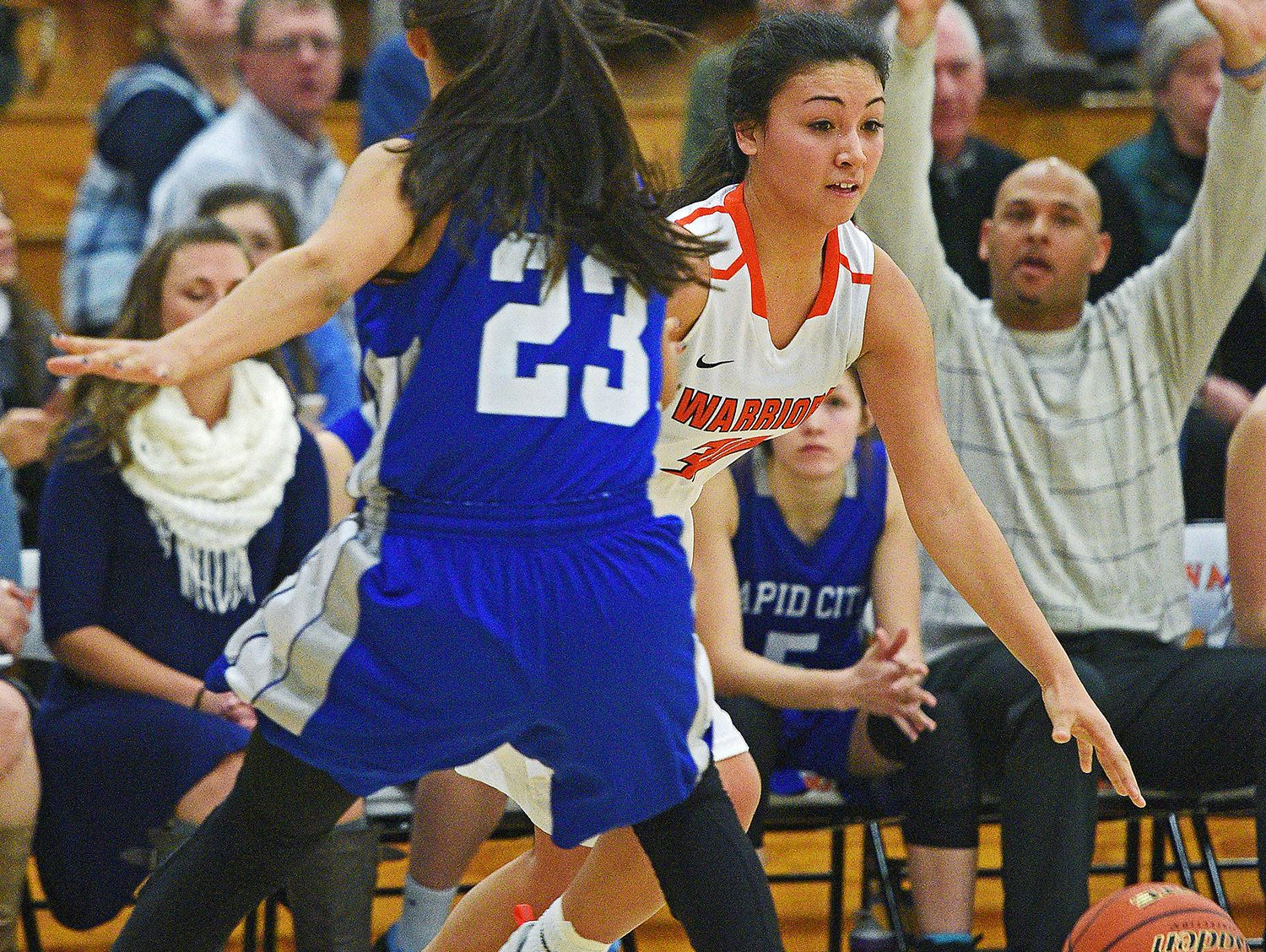 Washington's Taylor VanderVelde (30) tries to get past Rapid City Stevens' Lexus Eagle Chasing (23) during a game Friday, Feb. 10, 2017, at Washington High School in Sioux Falls.