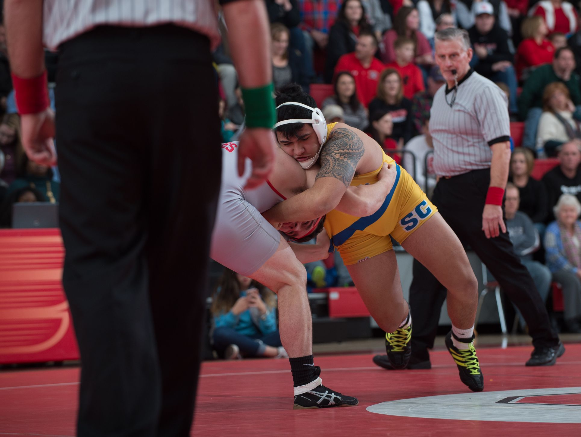 Sussex Central's John Morris, right, and Smyrna's Brent Young wrestle in the 220 pound match at Smyrna High School. Smyrna defeated Sussex Central 39-27.