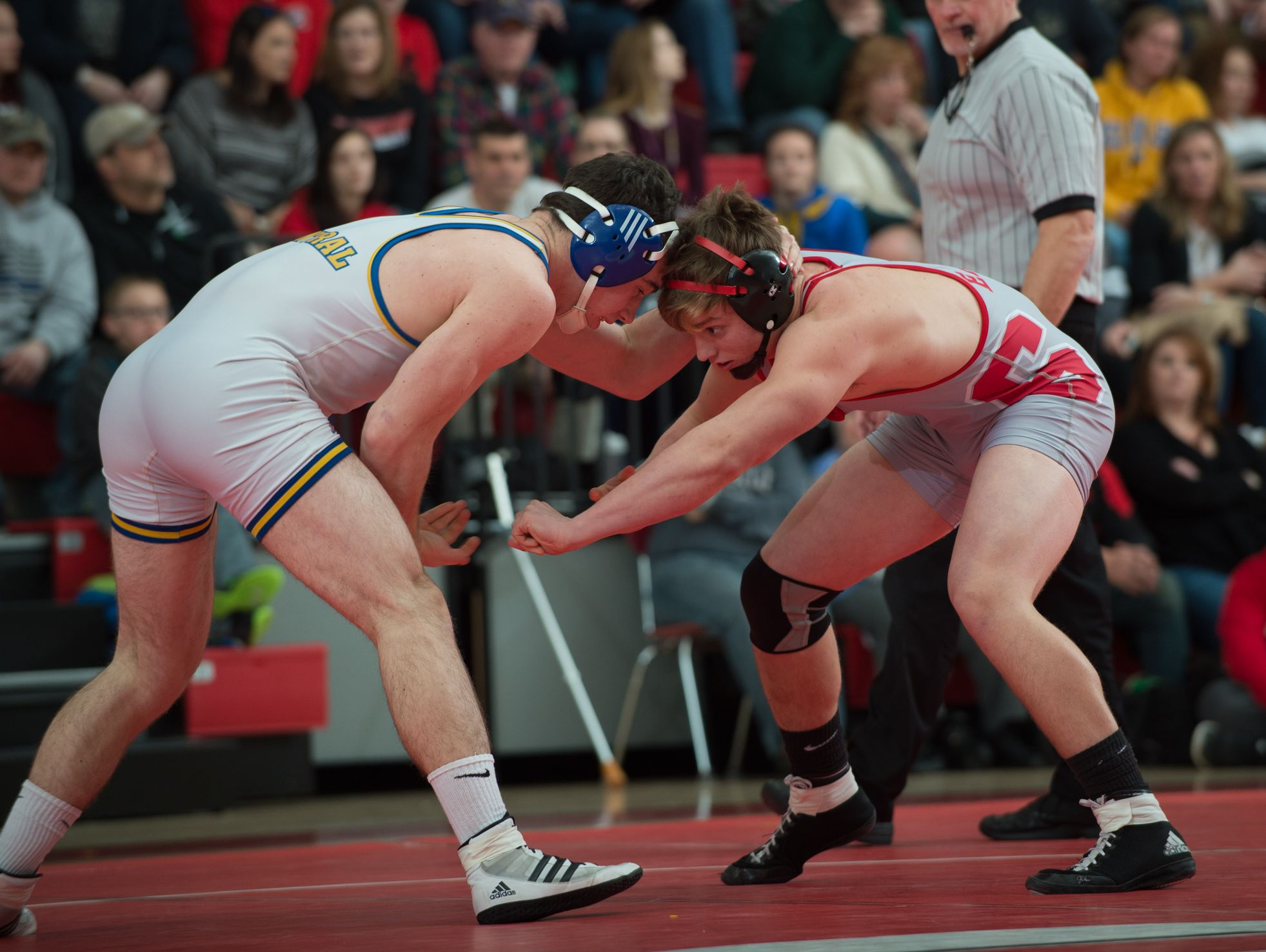 Sussex Central's Lucas Hudson, left, and Smyrna's Hunter Moyer battle for position in the 182 pound match at Smyrna High School. Smyrna defeated Sussex Central 39-27.