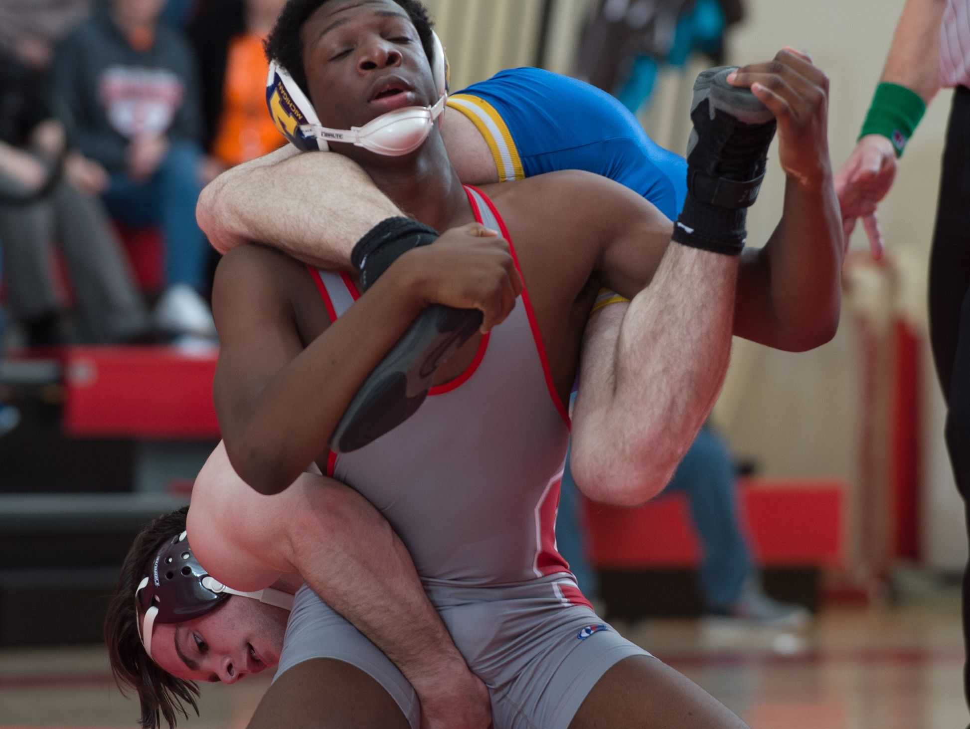 Sussex Central's Blake Chambers holds on to the back of Smyrna's Masen Wilson in the 170 pound match at Smyrna High School. Smyrna defeated Sussex Central 39-27.
