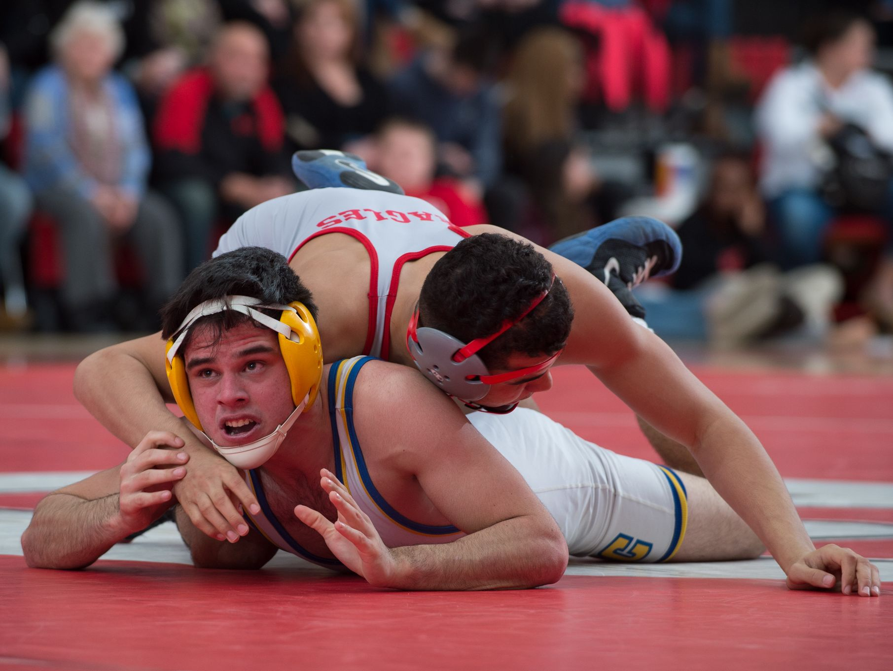 Sussex Central's Tyler Bunting, left, looks at the clock in his match against Smyrna's Nate Bryant in the 152 pound match at Smyrna High School. Smyrna defeated Sussex Central 39-27.