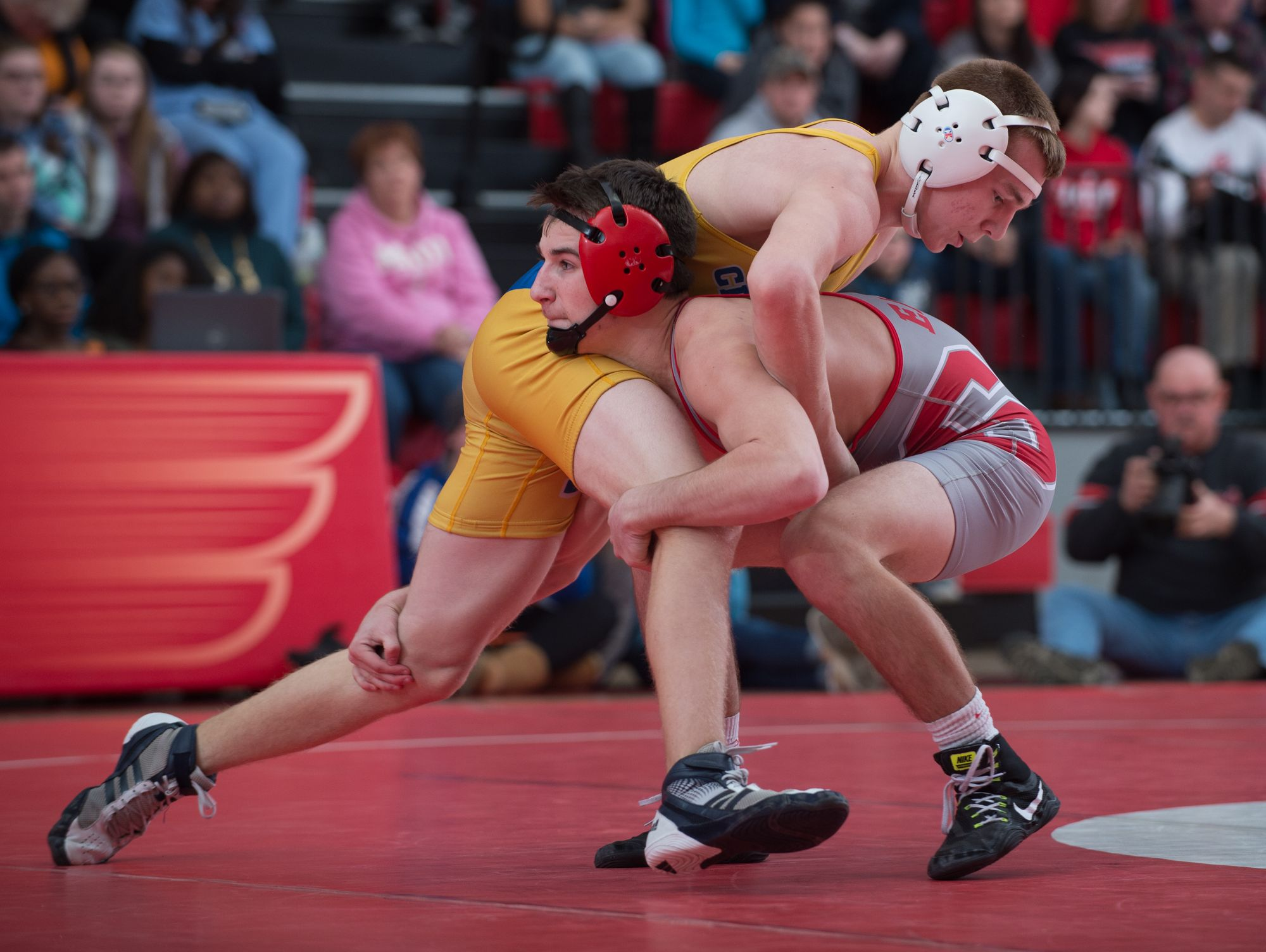 Sussex Central's Brandon Greenlee (top) and Smyrna's Greg Baum wrestle for position in the 132 pound match at Smyrna High School. Smyrna defeated Sussex Central 39-27.