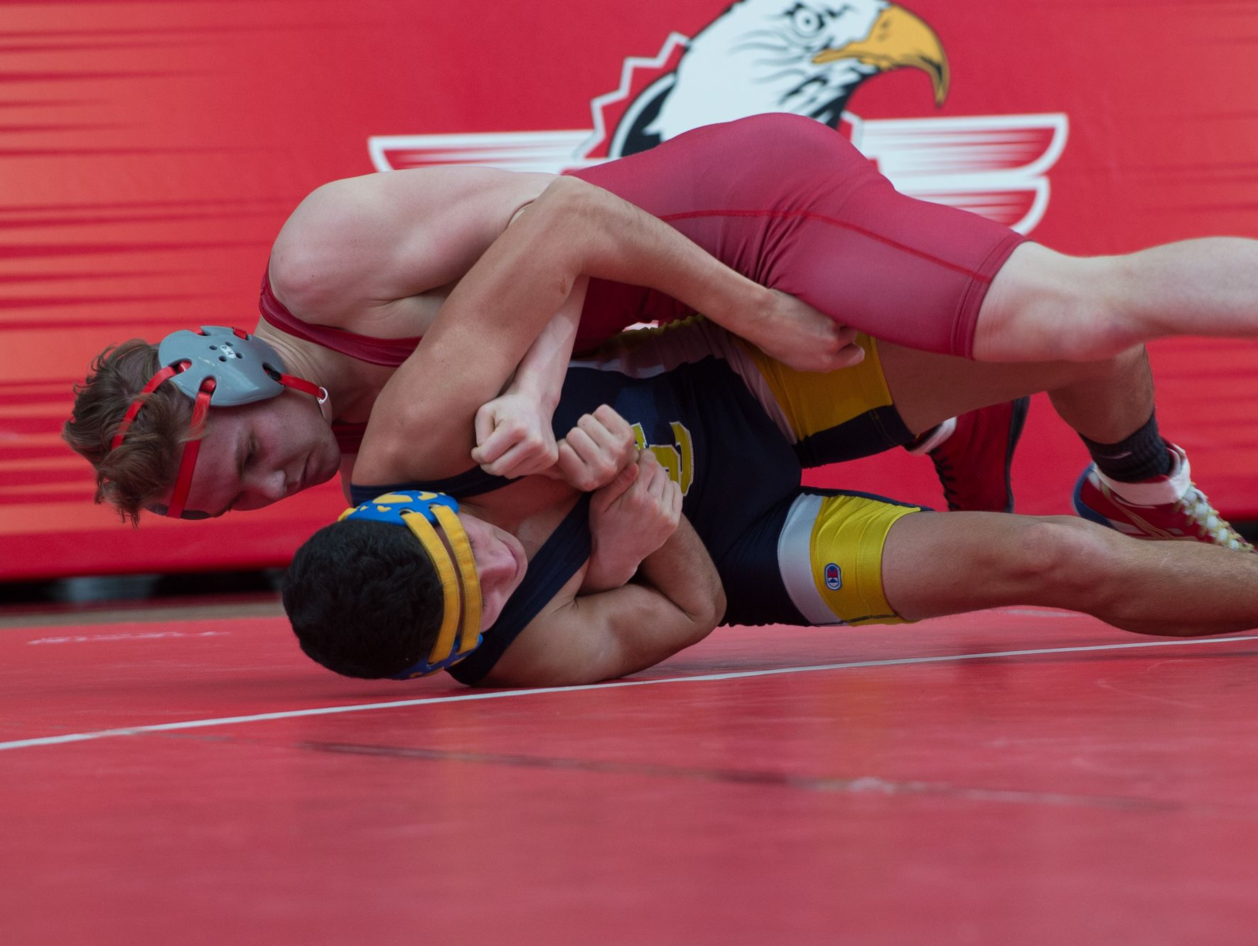 Smyrna's Cole Sebastianelli (top) tries to turn Sussex Central's Javier Perez on to his back in the 126 pound match at Smyrna High School. Smyrna defeated Sussex Central 39-27.