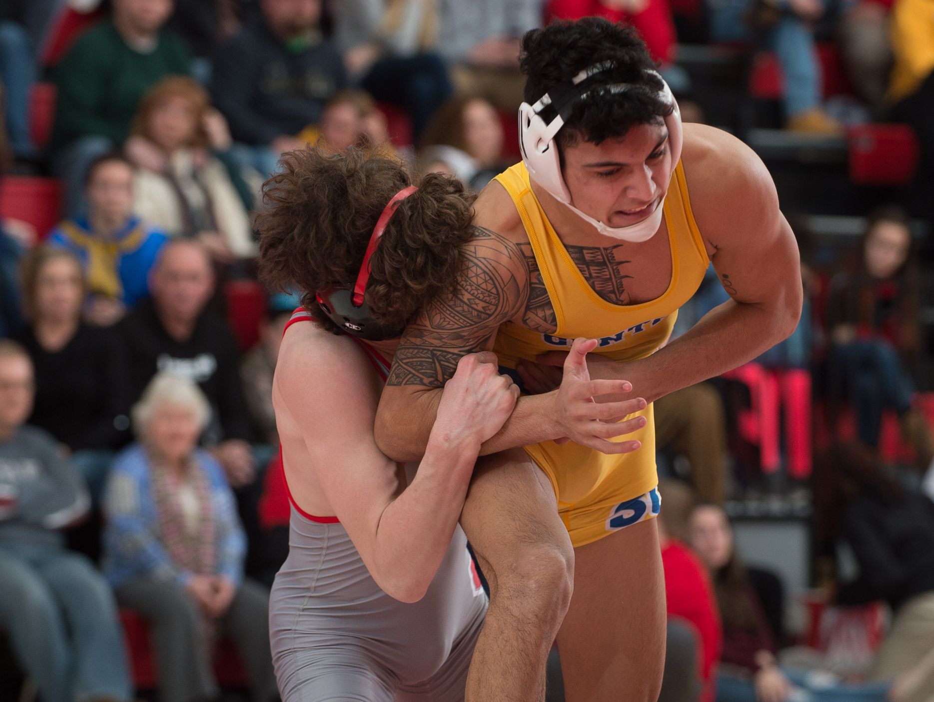 Smyrna's J.T. Davis, left, holds on to Sussex Central's Drew Morris in the 138 pound match at Smyrna High School. Smyrna defeated Sussex Central 39-27.