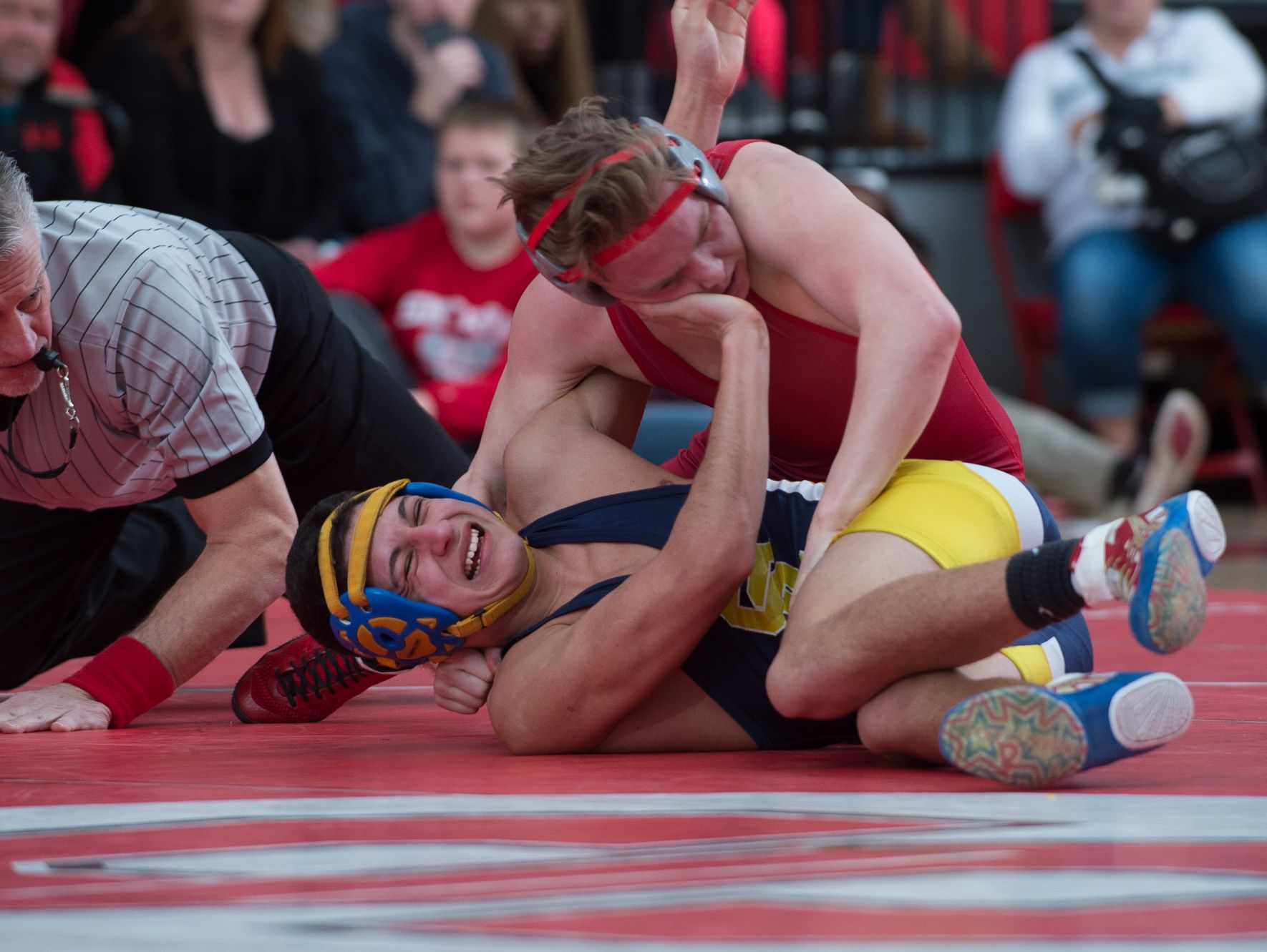Smyrna's Cole Sebastianelli (top) defeats Sussex Central's Javier Perez with a pin in the 126 pound match at Smyrna High School. Smyrna defeated Sussex Central 39-27.