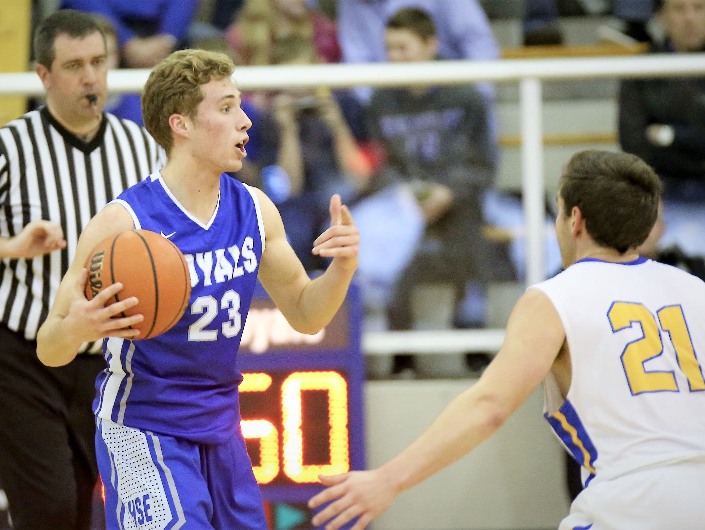 Hamilton Southeastern's Connor Rotterman looks for an open teammate in the Royals' win over Carmel on Friday night.