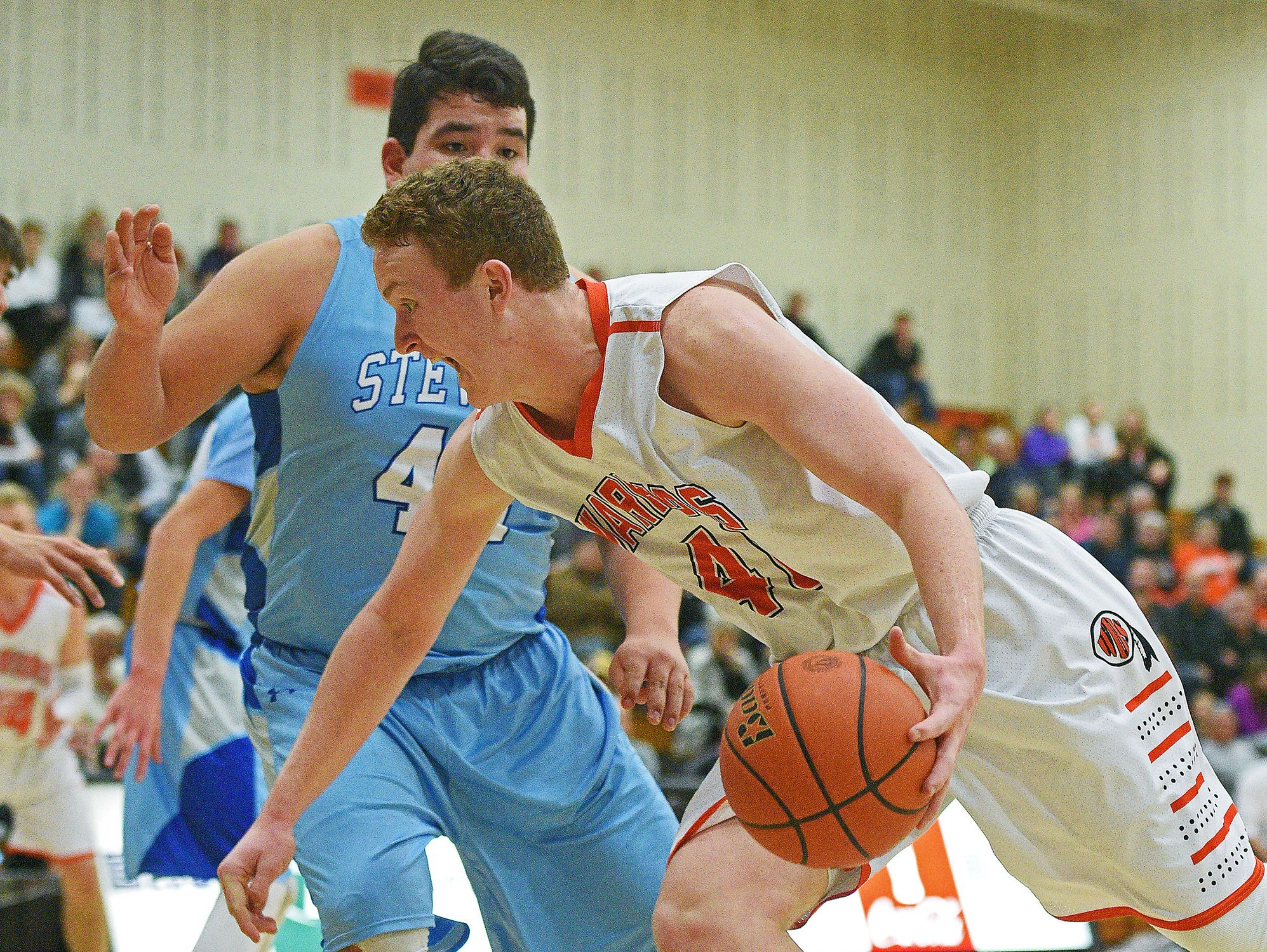Washington's Zach Heins (40) drives past Rapid City Stevens' Jordan Lawrence (44) during a game Friday, Feb. 10, 2017, at Washington High School in Sioux Falls.
