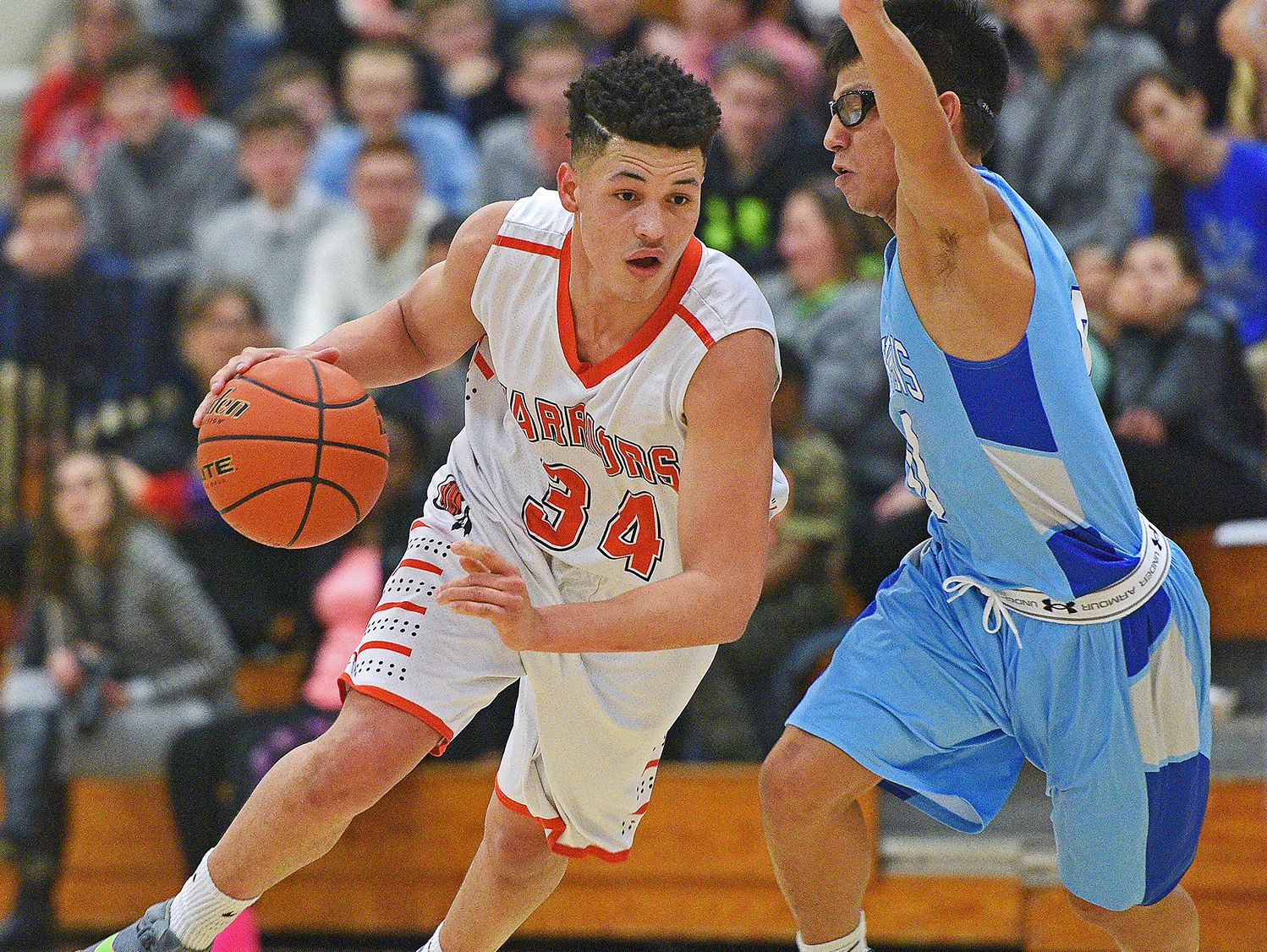 Washington's Angel Arroyo (34) drives past Rapid City Stevens' Andrew Cottier (0) during a game Friday, Feb. 10, 2017, at Washington High School in Sioux Falls.