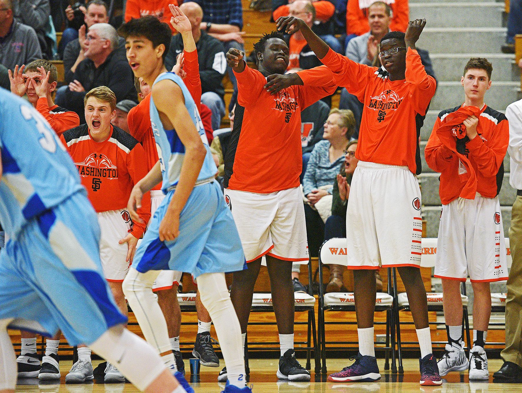 Washington players react from the bench after a teammate scored during a game against Rapid City Stevens Friday, Feb. 10, 2017, at Washington High School in Sioux Falls.