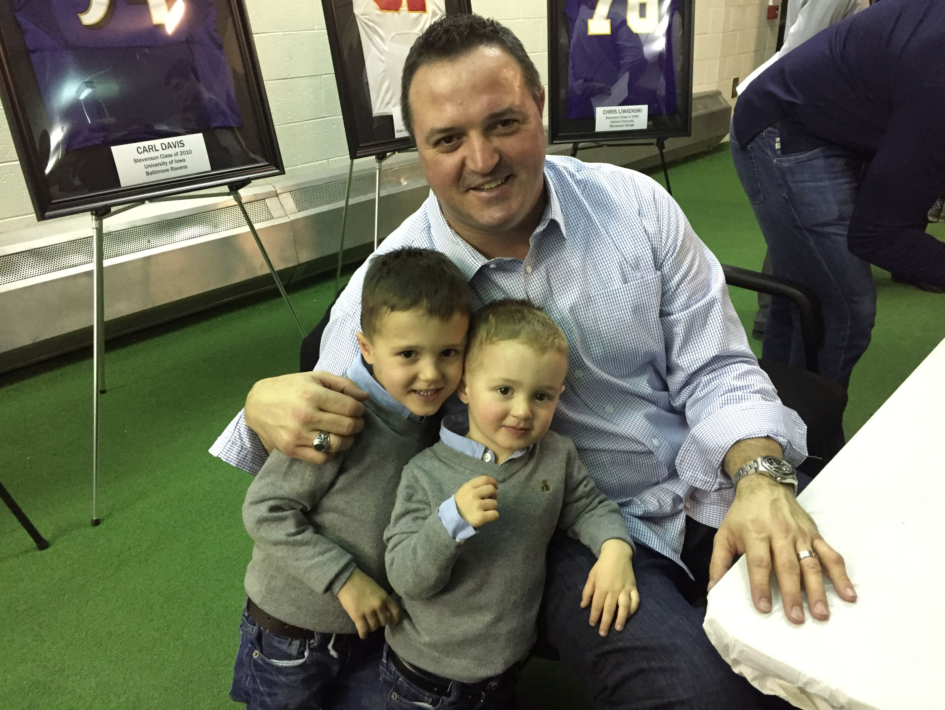Former Sterling Heights Stevenson High and Detroit Lions standout Pete Chryplewicz poses for a picture with his sons last month during a jersey ceremony at Stevenson on Jan. 26, 2017.