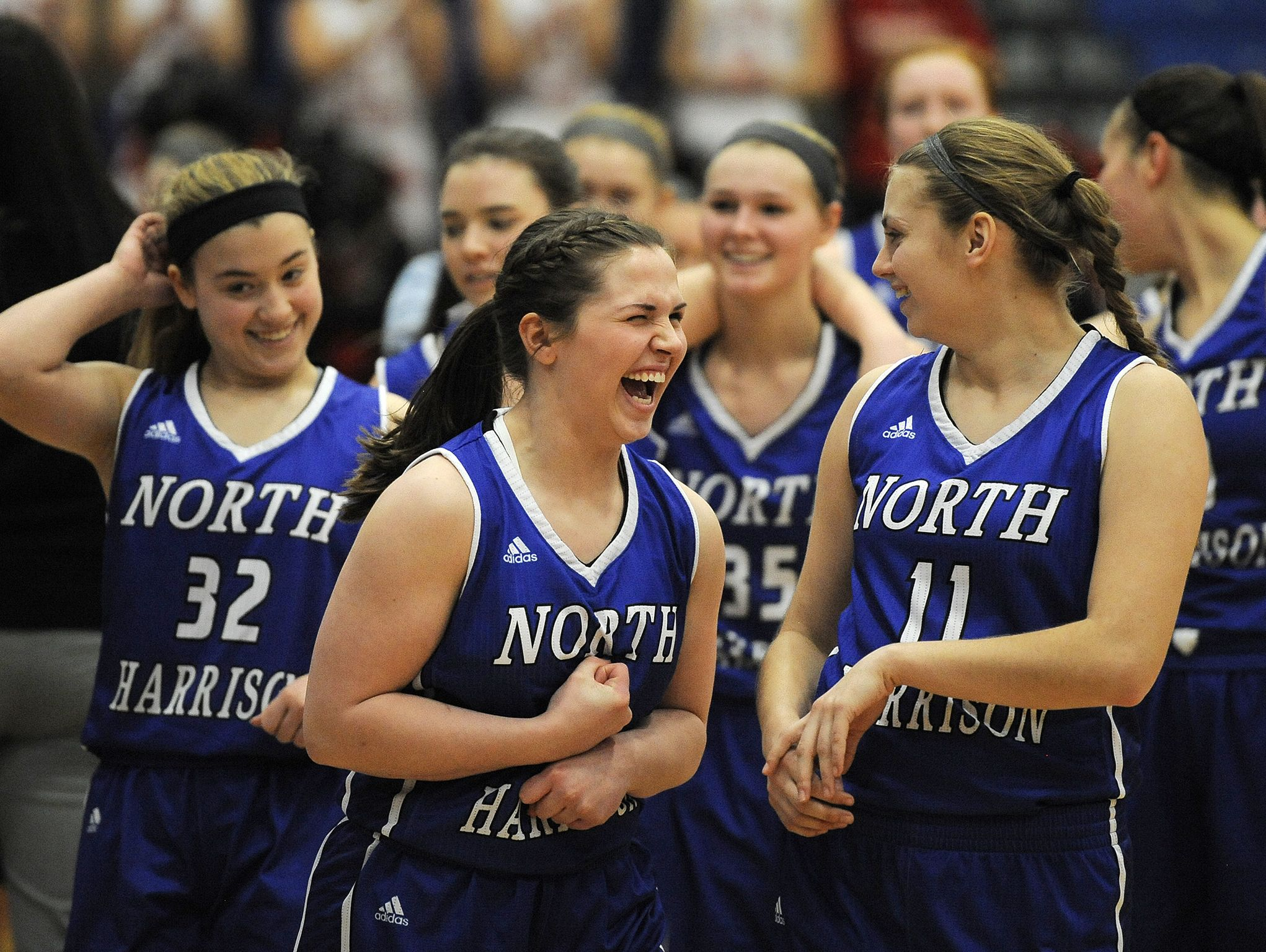 North Harrison's Savana Rhodes (center) celebrates the Lady Cat's 58-42 win against Rushville on Saturday during the Regional #8 semi-final game #2 at Charlestown High School. (Photo by David Lee Hartlage, Special to The Courier-Journal) Feb.11, 2017