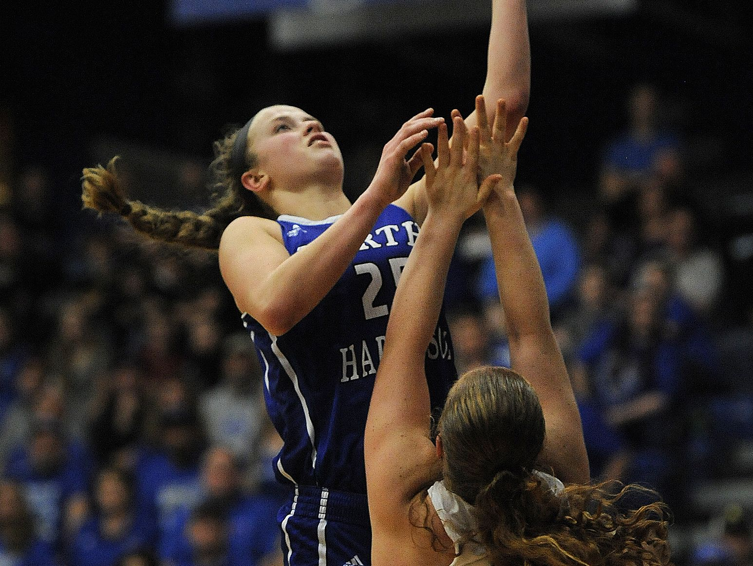 North Harrison's Cali Nolot (left) shoots against Rushville's Alisha Markley (22) on Saturday during the Regional #8 semi-final game #2 at Charlestown High School. North Harrison won 58-42. (Photo by David Lee Hartlage, Special to The Courier-Journal) Feb. 11, 2017