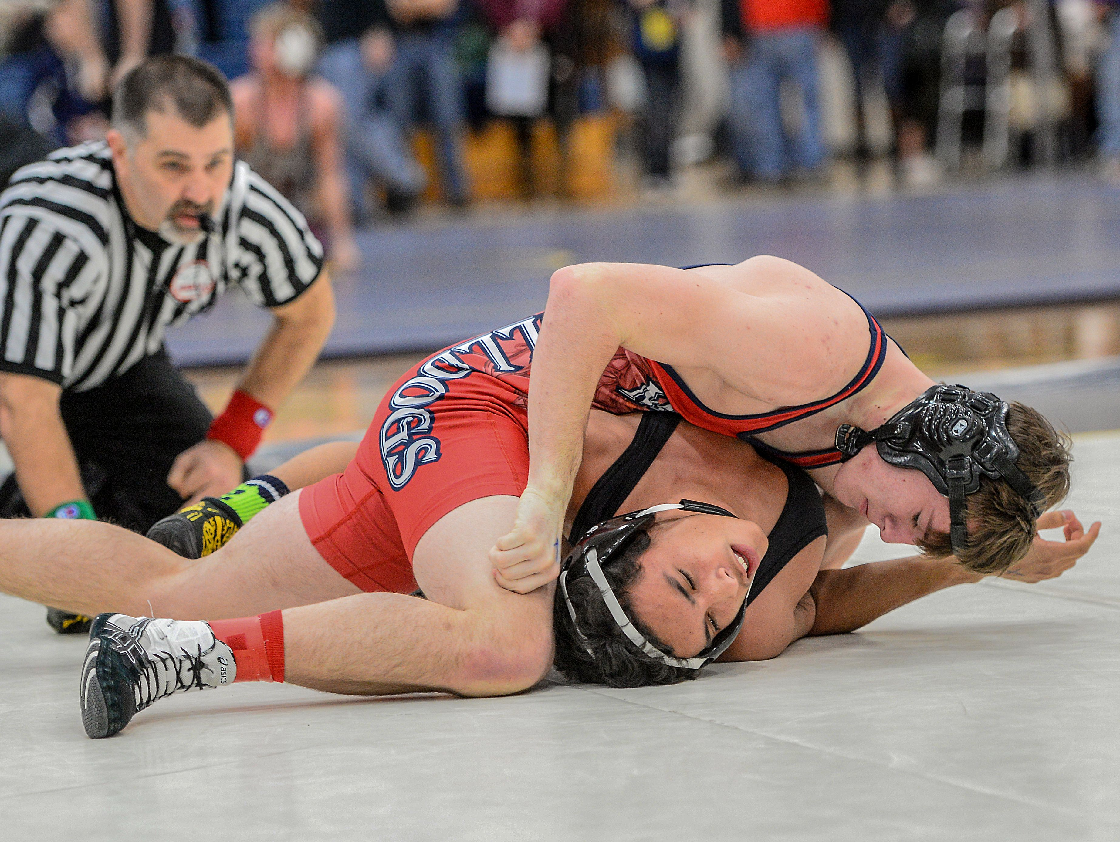Mason's Will Muenzenmaier, top, defeats Jose Bonilla, from Waverly 14-12 in the 145 weight class in OT at the D2 District tournament held at DeWitt Saturday, February 11, 2017.