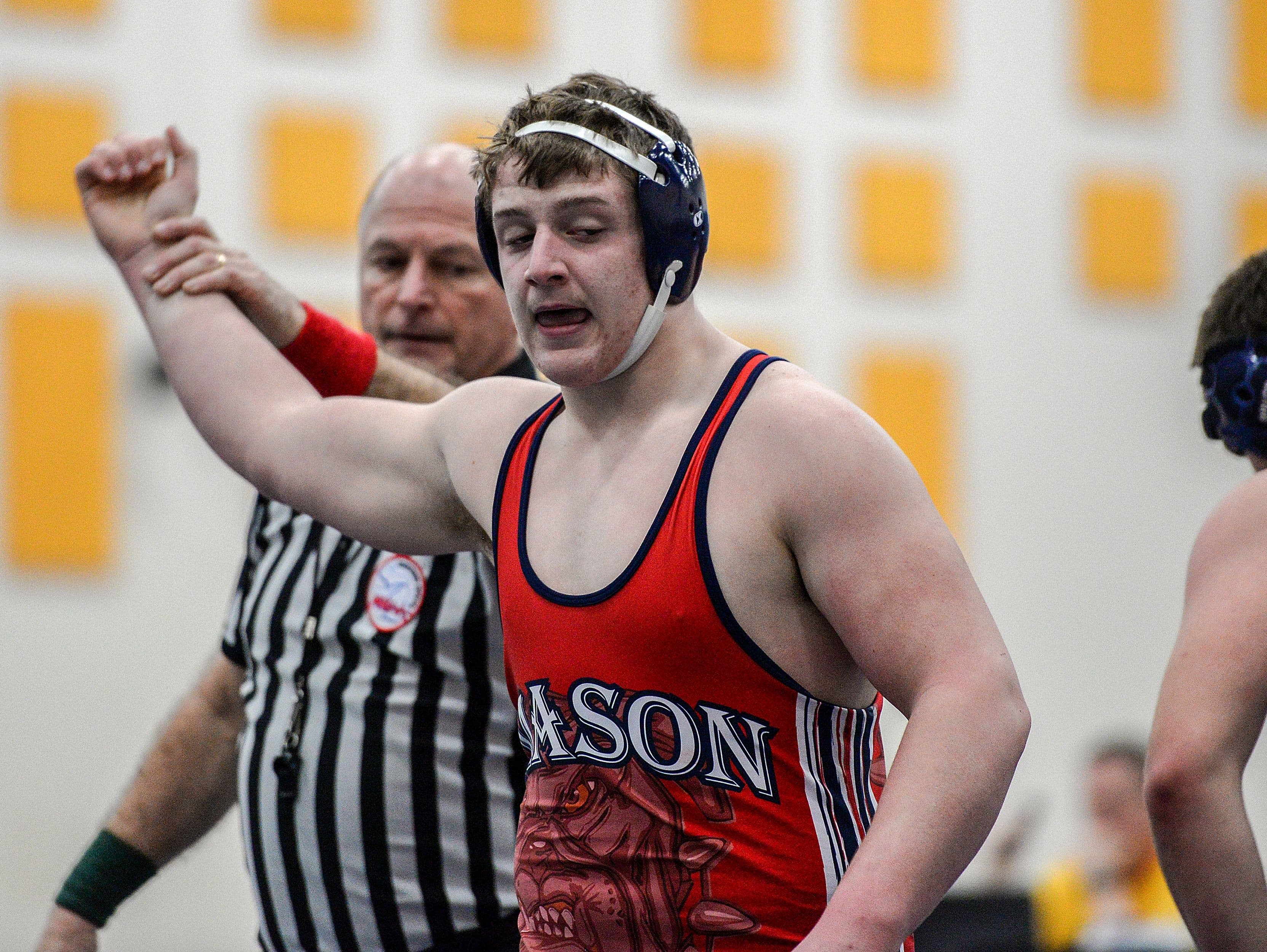 Mason's Ben Surato, gets the pin for the win over Chelsea's Zach Taylor in the 215 weight class at the D2 District tournament held at DeWitt Saturday, February 11, 2017.