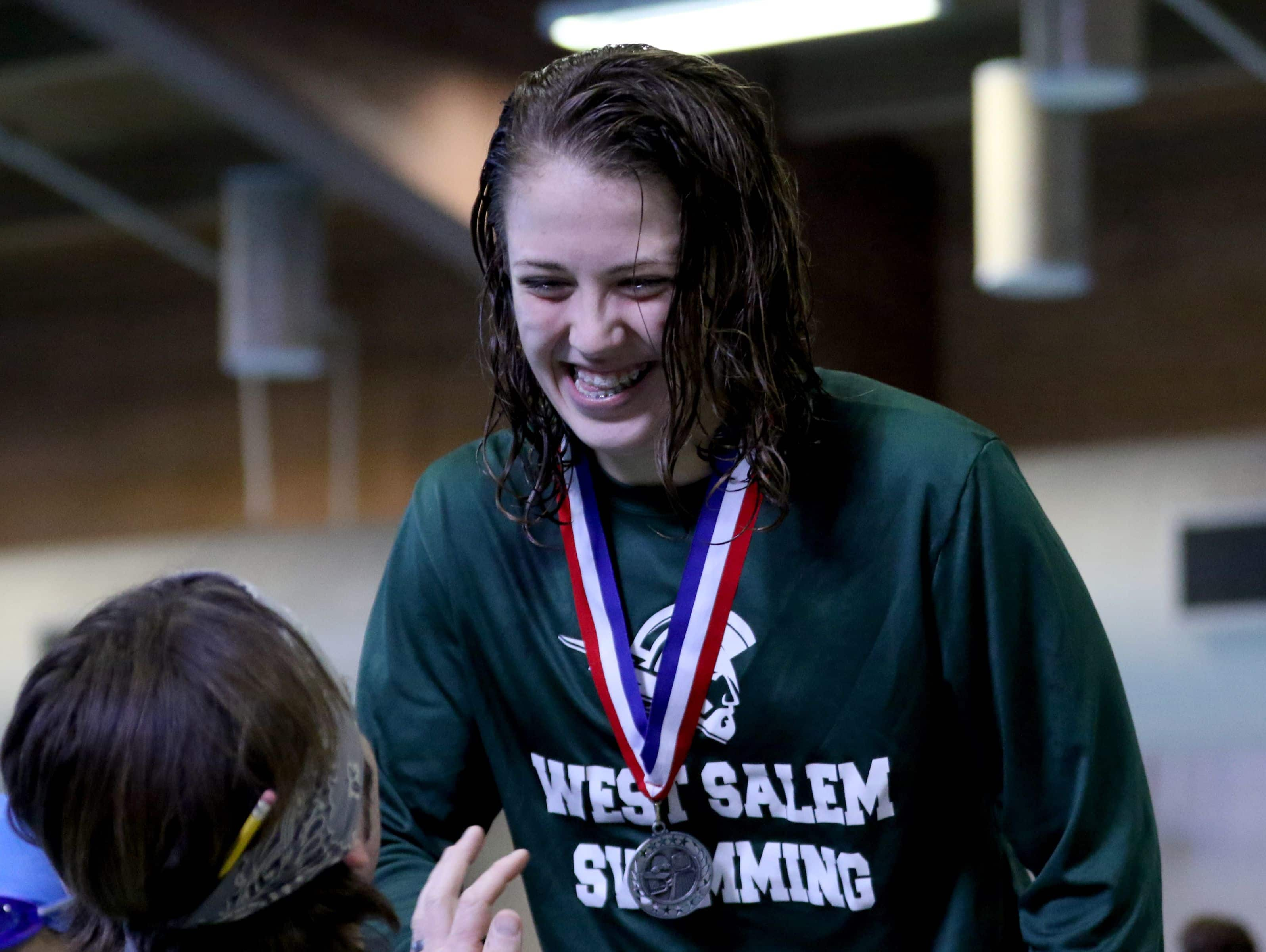 West Salem's Hannah Bodkin accepts her silver medal for the 200 yard individual medley in the during the Greater Valley Conference swimming championships at the McMinnville Aquatic Center on Saturday, Feb. 11, 2017.