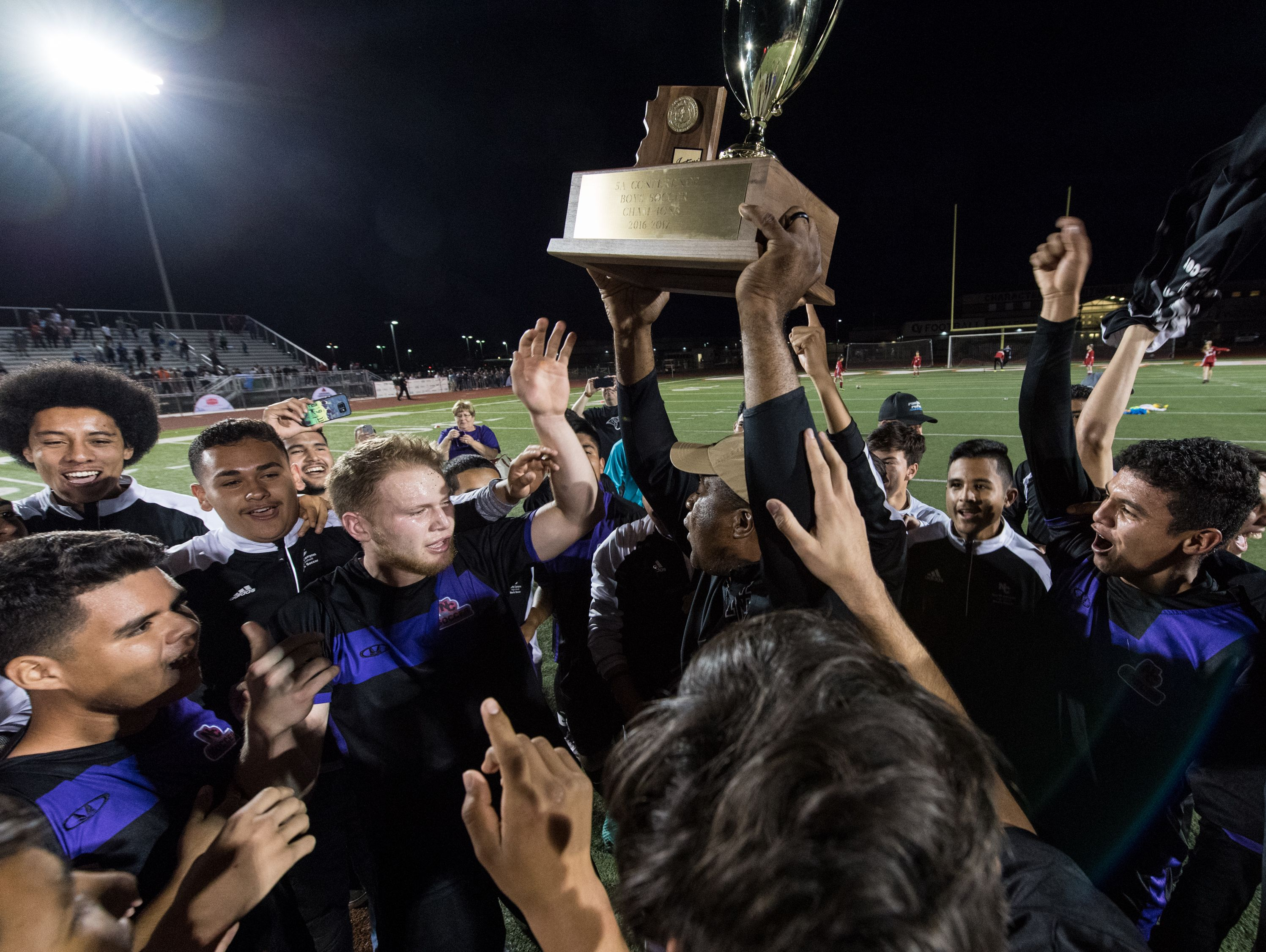 North Canyon receive their 5A Conference state championship trophy on Saturday, Feb. 11, 2017, at Campo Verde High School in Gilbert, Ariz.