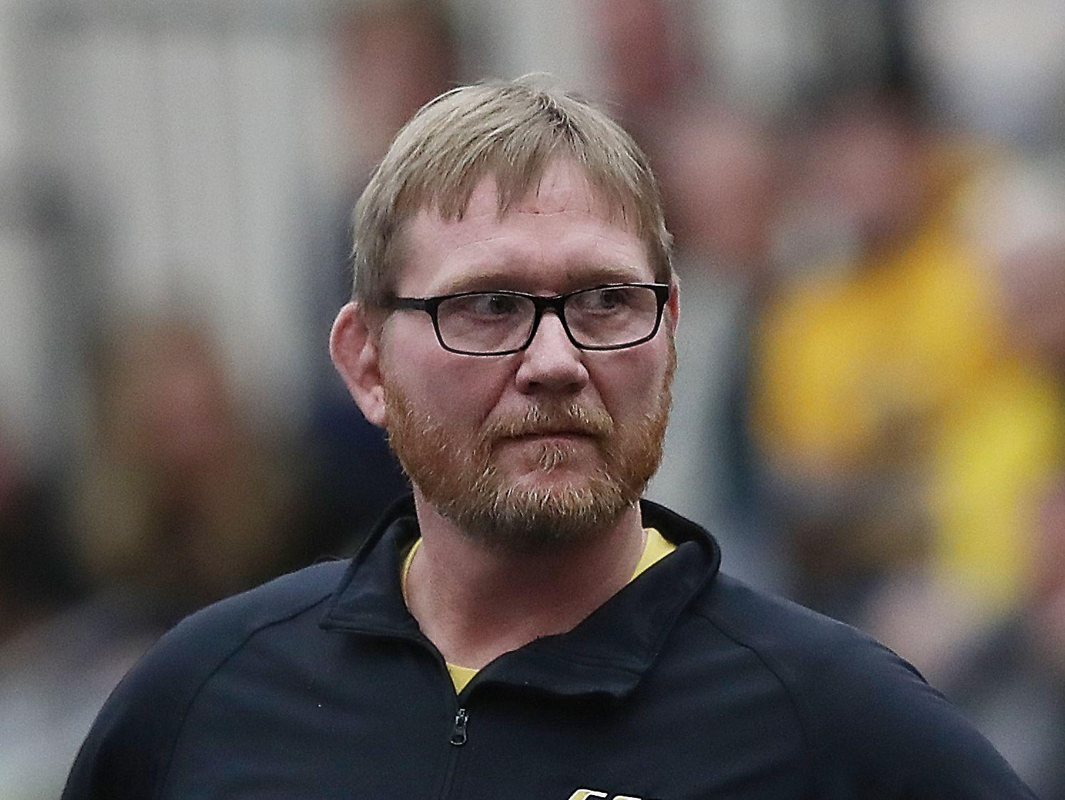 Southeast Polk Head Coach Jason Christenson watches his team during the 3A District 1 wrestling tournament at Ankeny Centennial High School.