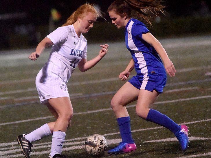 Loyola senior Rebecca Mays maneuveers around a defender in a playoff game earlier this season.