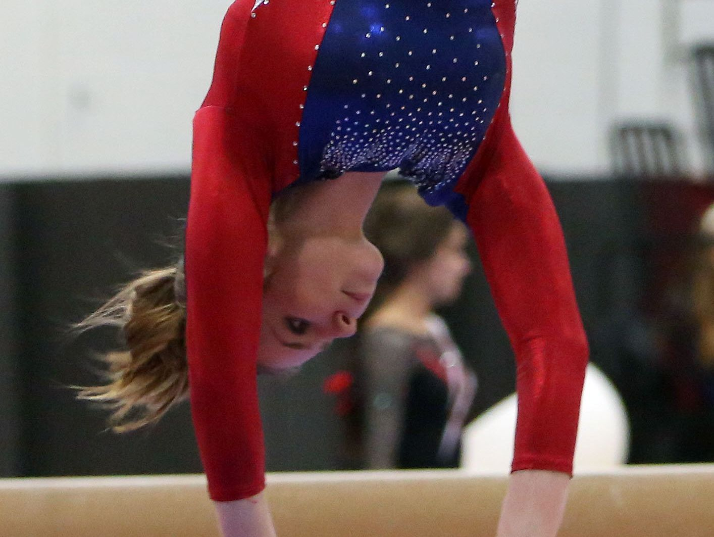 Wappingers' Olivia Frederick competes on the balance beam during the Section 1 gymnastics championship at Carmel High School Feb. 14, 2017.