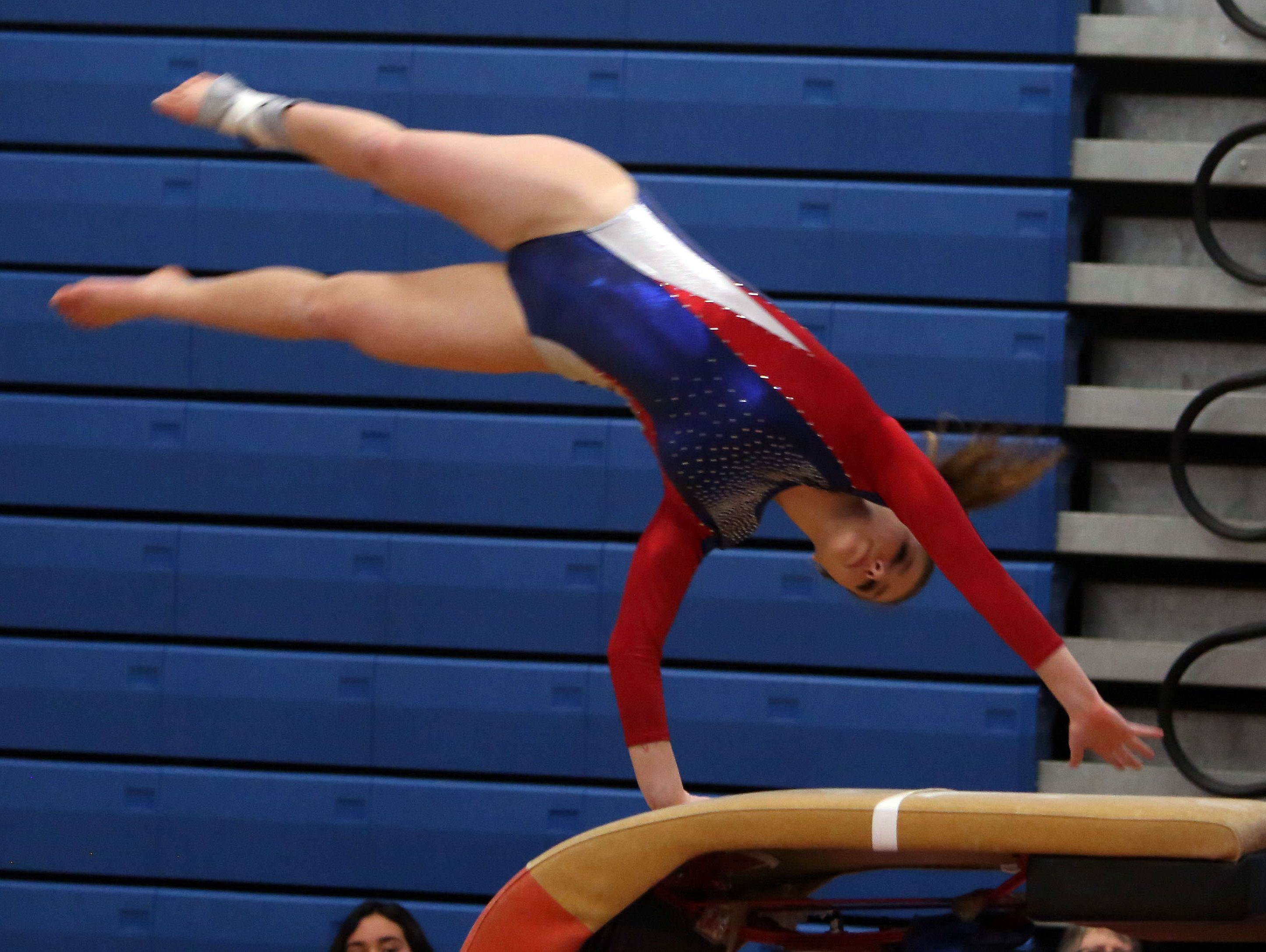 Wappingers' Olivia Frederick competes in the vault during the Section 1 gymnastics championship at Carmel High School Feb. 14, 2017.