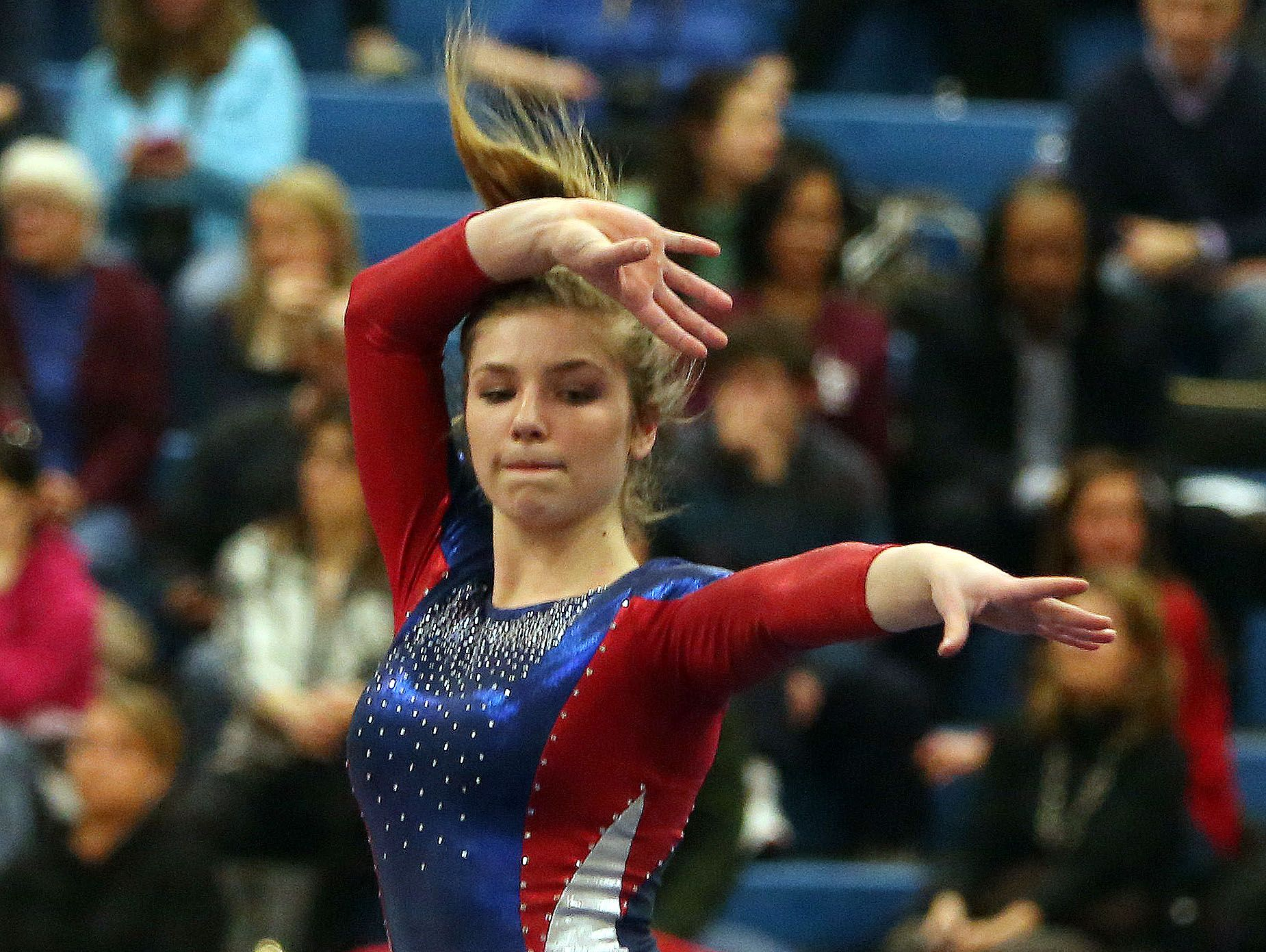 Wappingers' Olivia Frederick competes in the floor exercise during the Section 1 gymnastics championship at Carmel High School on Tuesday.