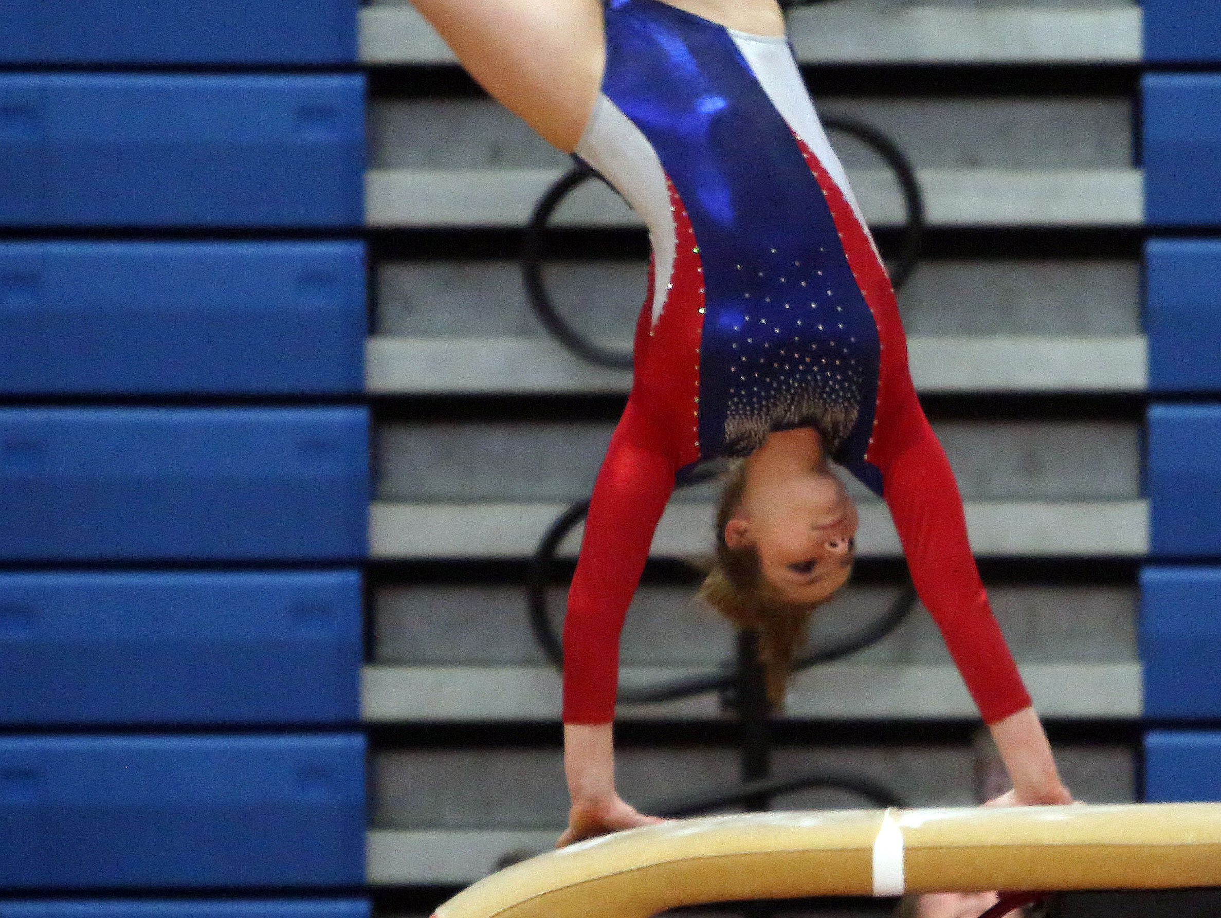 Wappingers' Olivia Frederick competes in the vault during the Section 1 gymnastics championship at Carmel High School on Tuesday.