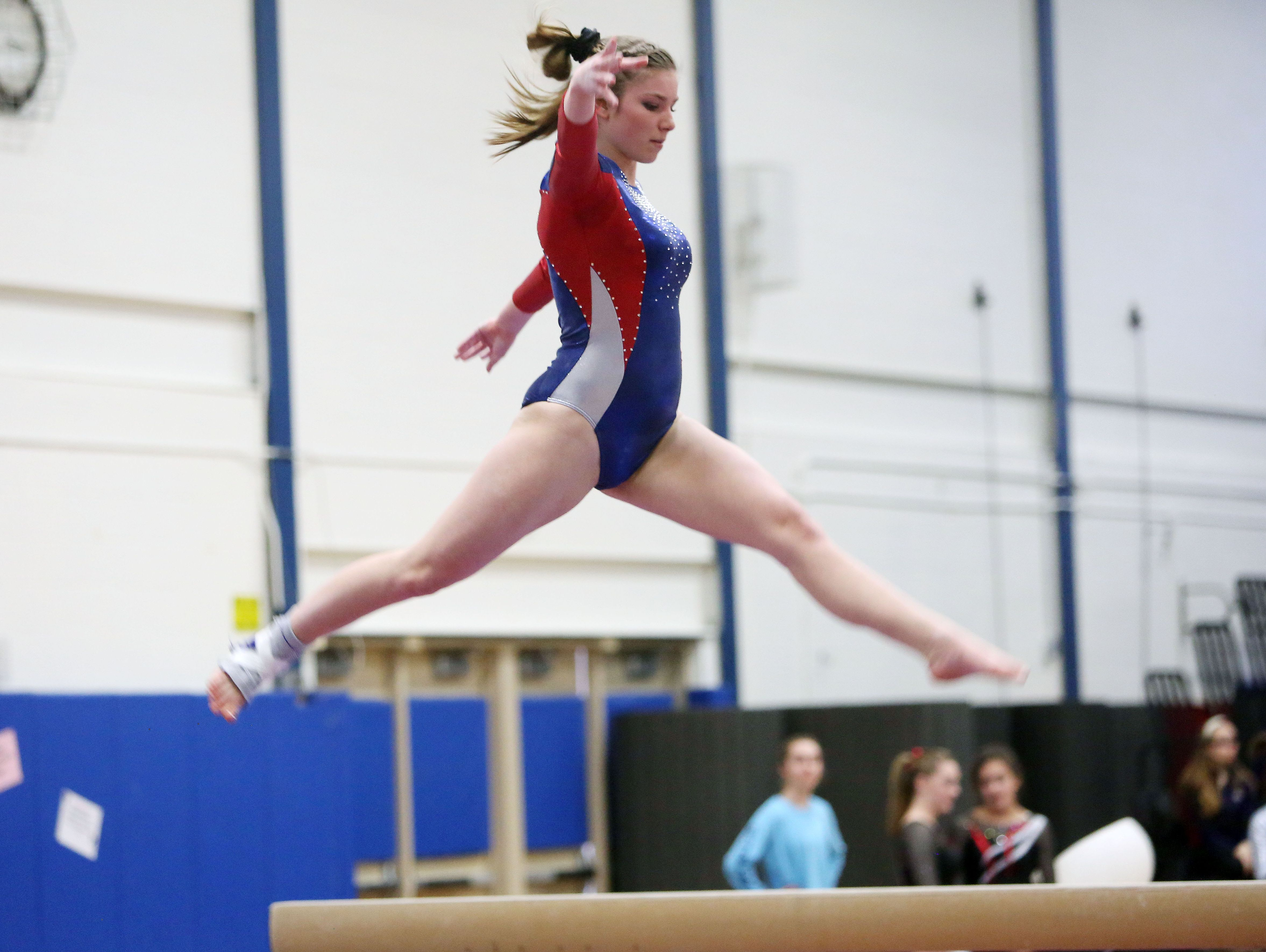 Wappingers' Olivia Frederick competes on the balance beam during the Section 1 gymnastics championship at Carmel High School on Tuesday.