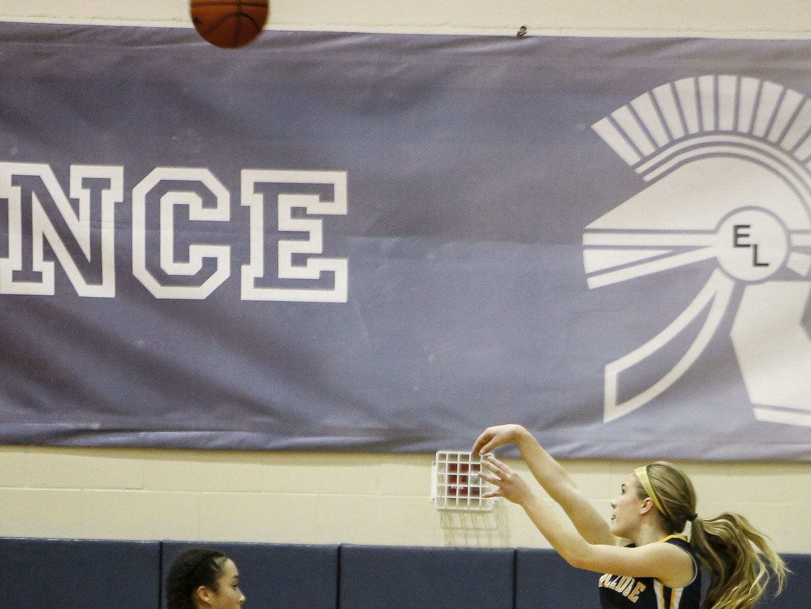 Grand Ledge senior Brooke Rambo connects from three-point land against East Lansing Tuesday, Feb. 14, 2017, at East Lansing.