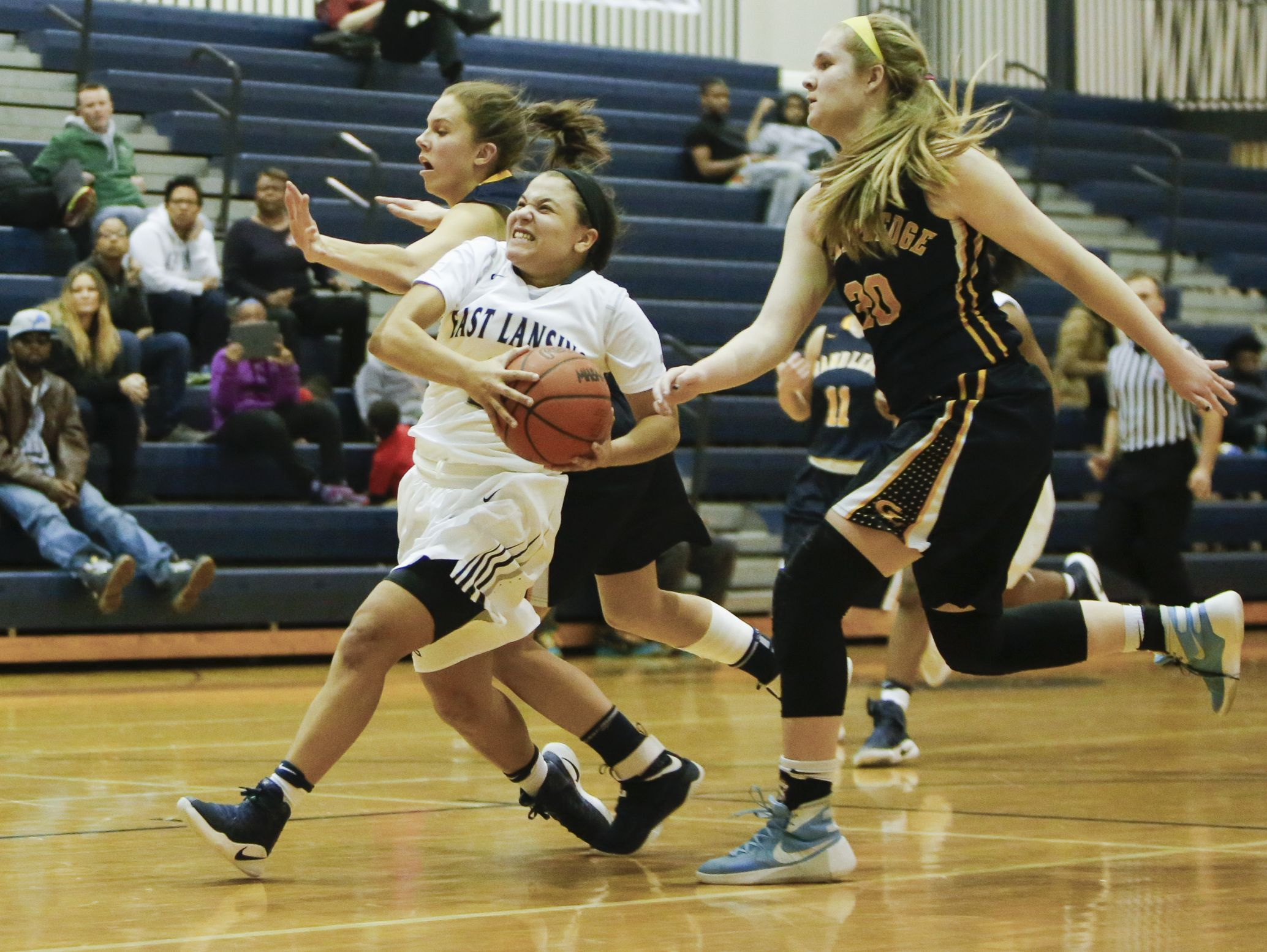 East Lansing junior Amelia McNutt drives into the paint against Grand Ledge Tuesday, Feb. 14, 2017, at East Lansing.