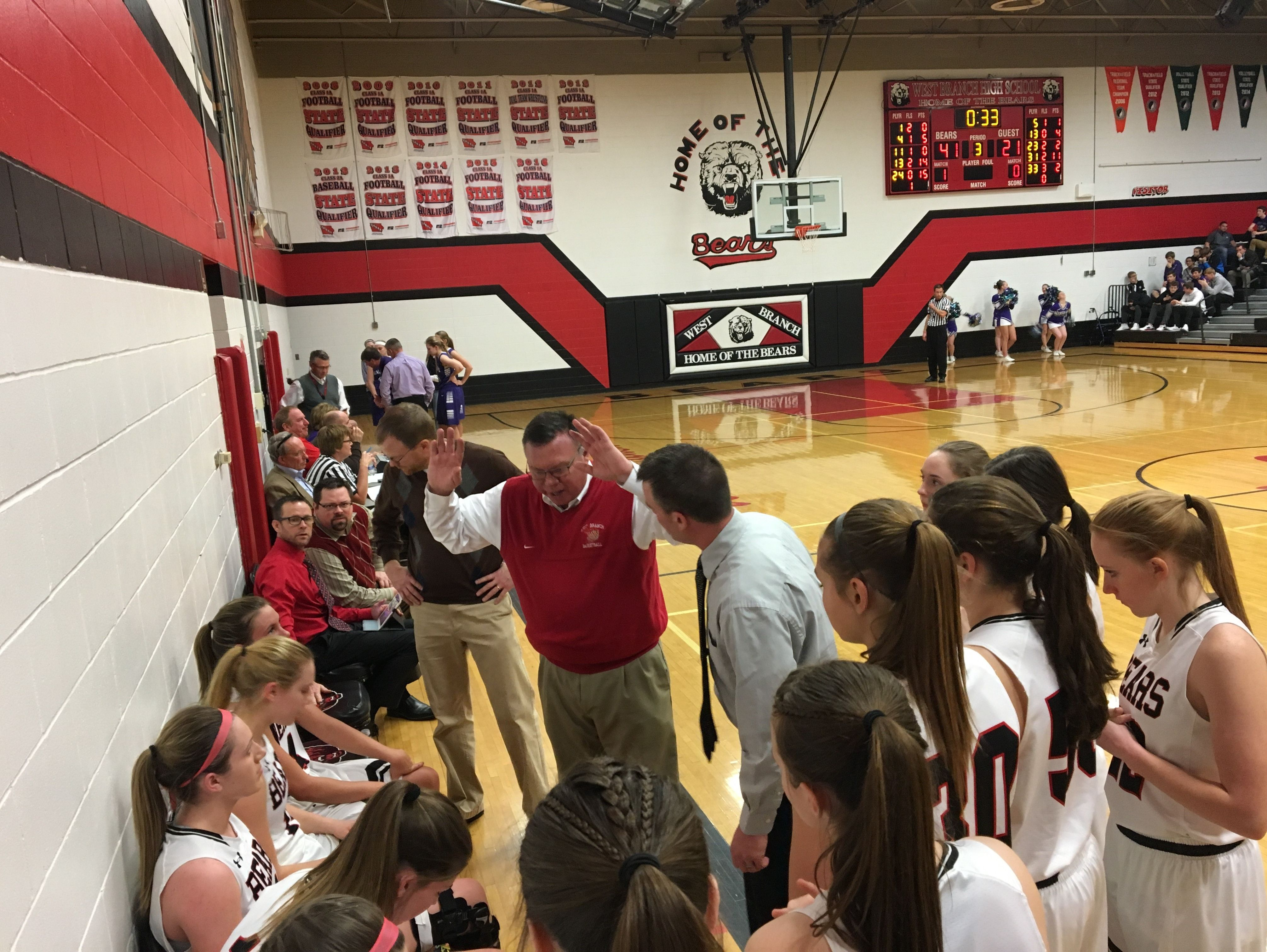 West Branch coaches address their team in a timeout during the Bears' regional playoff game against North Cedar.