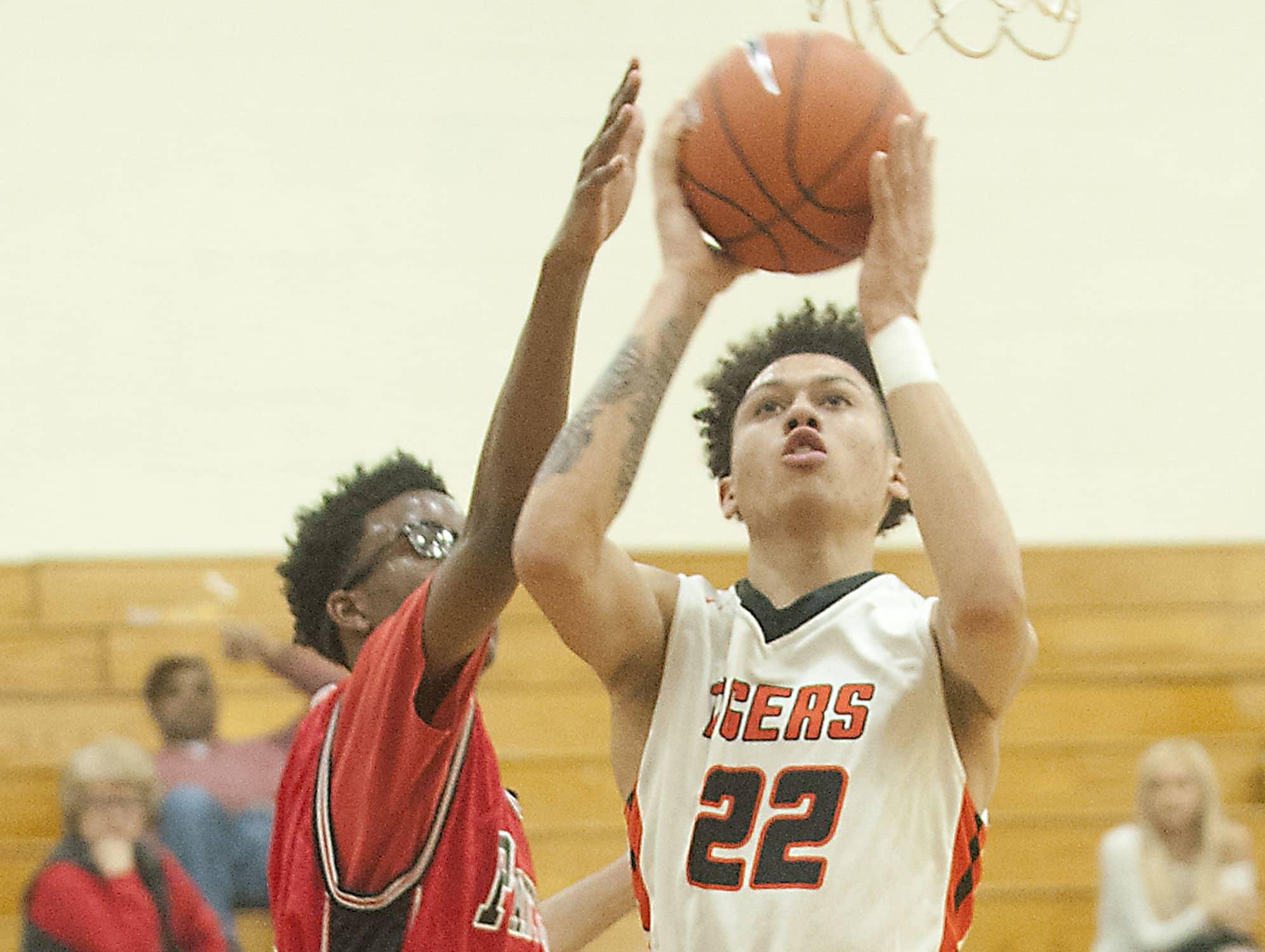 Fern Creek guard-forward Chance Moore puts up a shot over Pleasure Ridge Park center Micah Kinnebrew. Pleasure Ridge Park forward Darius Osborne pressures from behind. 15 February 2017