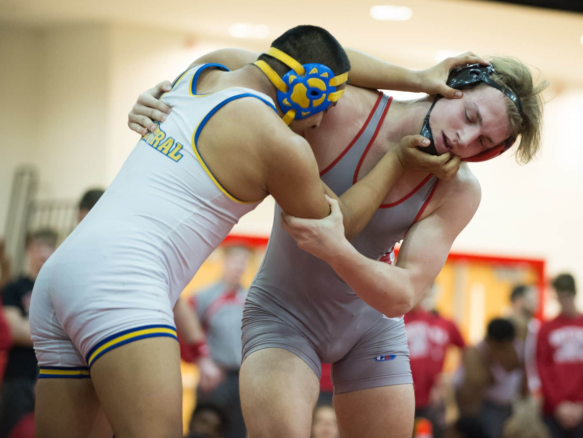 Sussex Central's Mario Santizo, left and Smyrna's Tony Wuest battles for position in the 220 pound match at DIAA Dual Meet Wrestling State Championship at Smyrna High School.