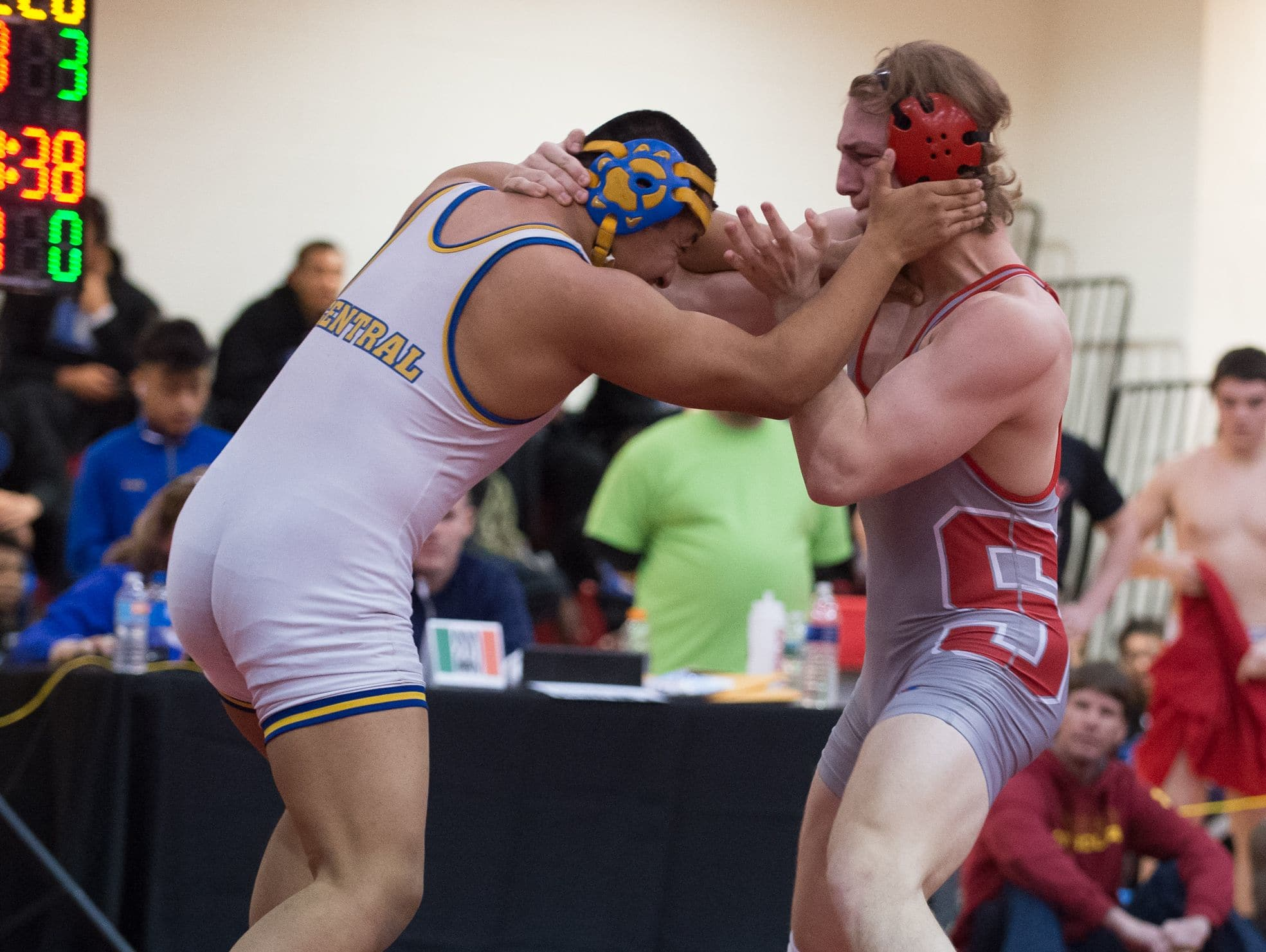 Sussex Central's Mario Santizo, left and Smyrna's Tony Wuest face off in the 220 pound match at DIAA Dual Meet Wrestling State Championship at Smyrna High School.
