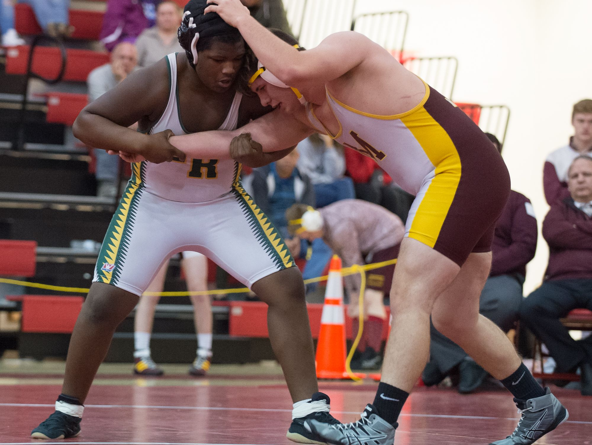 Indian River's Ramond Turner, left and Milford's Bryon Wynes wrestle in the 285 pound match at DIAA Dual Meet Wrestling State Championship at Smyrna High School.