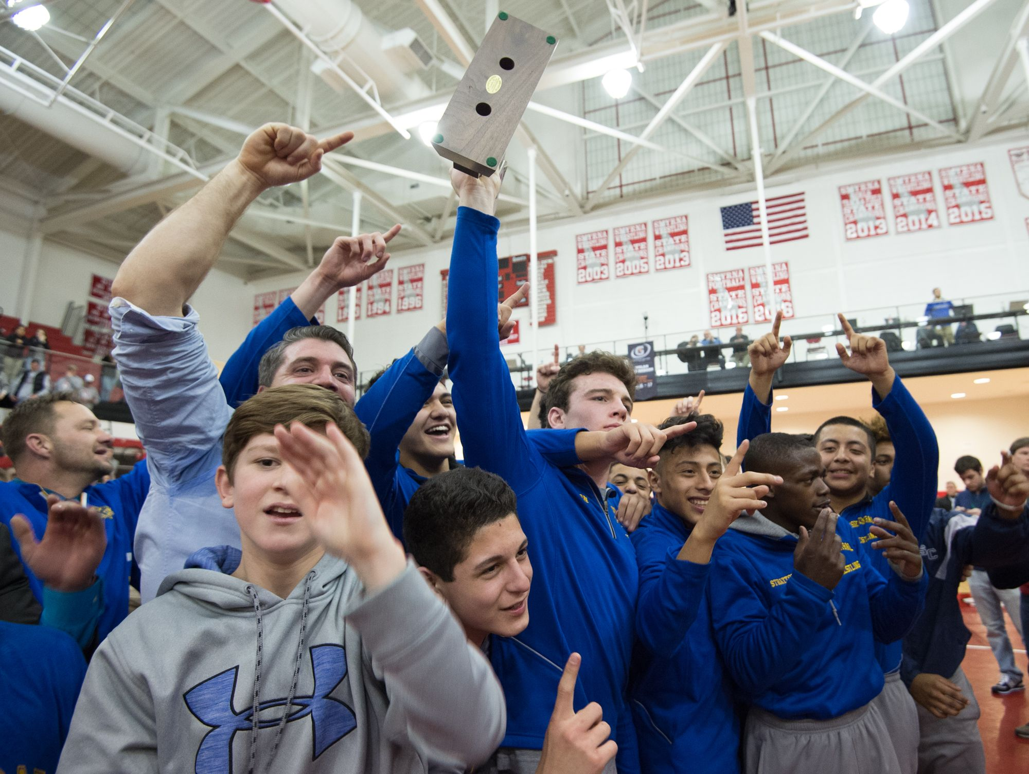 Sussex Central celebrates after defeating Smyrna in the DIAA Dual Meet Wrestling State Championship at Smyrna High School.