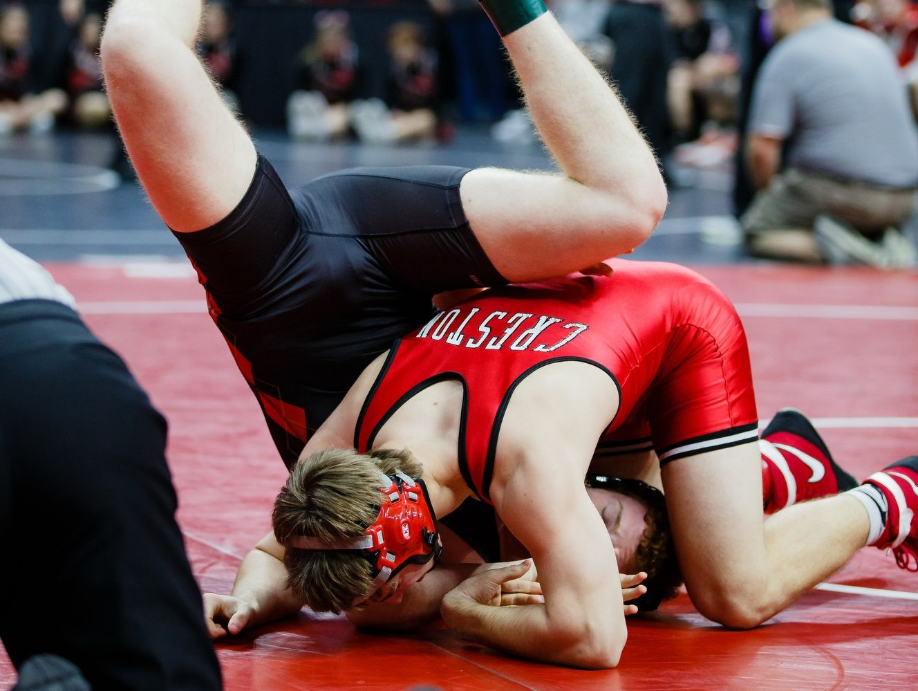 during their match at the Wrestling State Team Dual tournament on Wednesday, Feb. 15, 2017 in Des Moines.