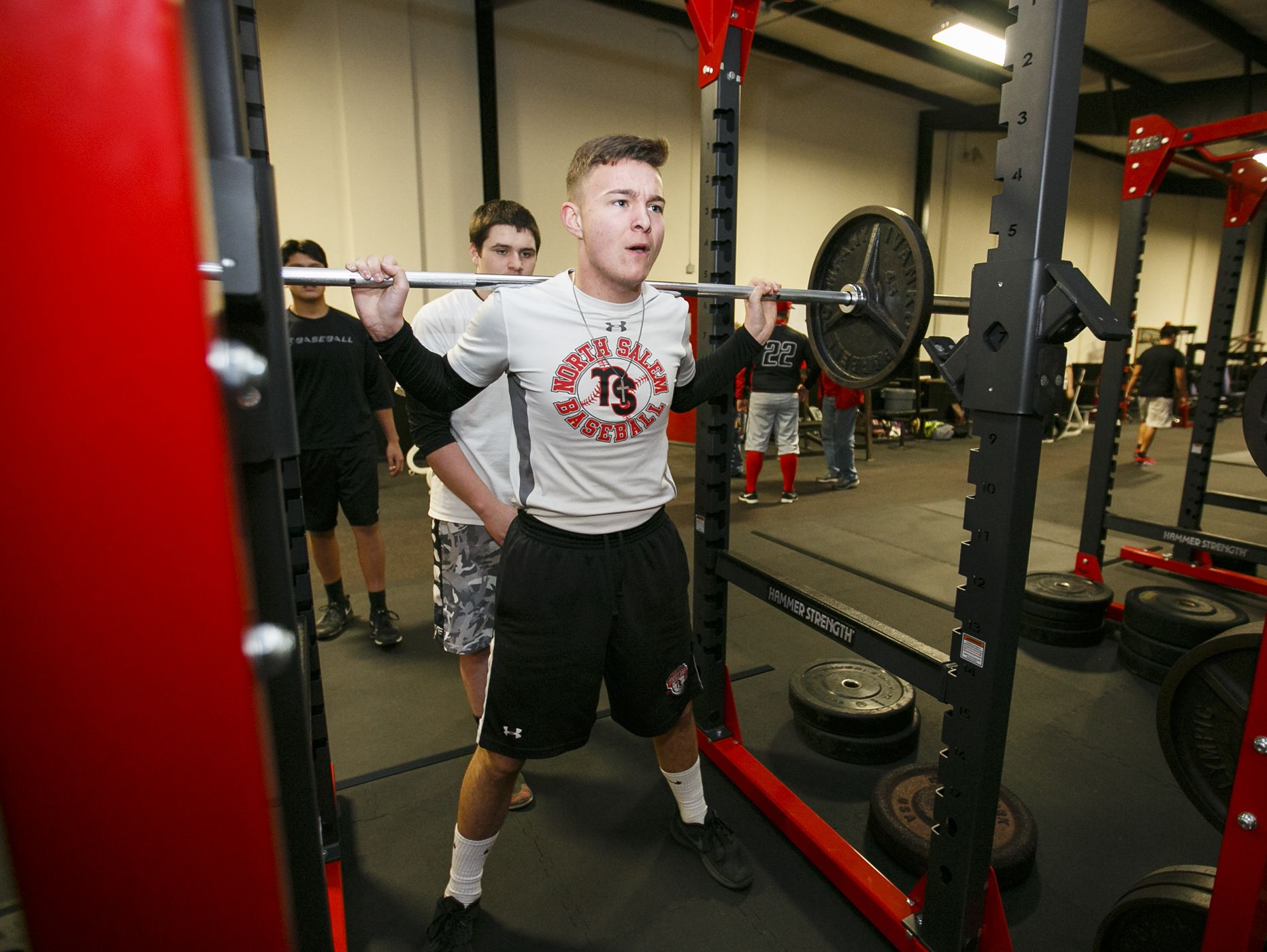Senior Jared Lund does squats in North Salem High School's newly remodeled weight room on Tuesday, Feb. 14, 2017. The facility includes new rubber floors, eight new weight lifting racks, four new spin bikes and new free weights.