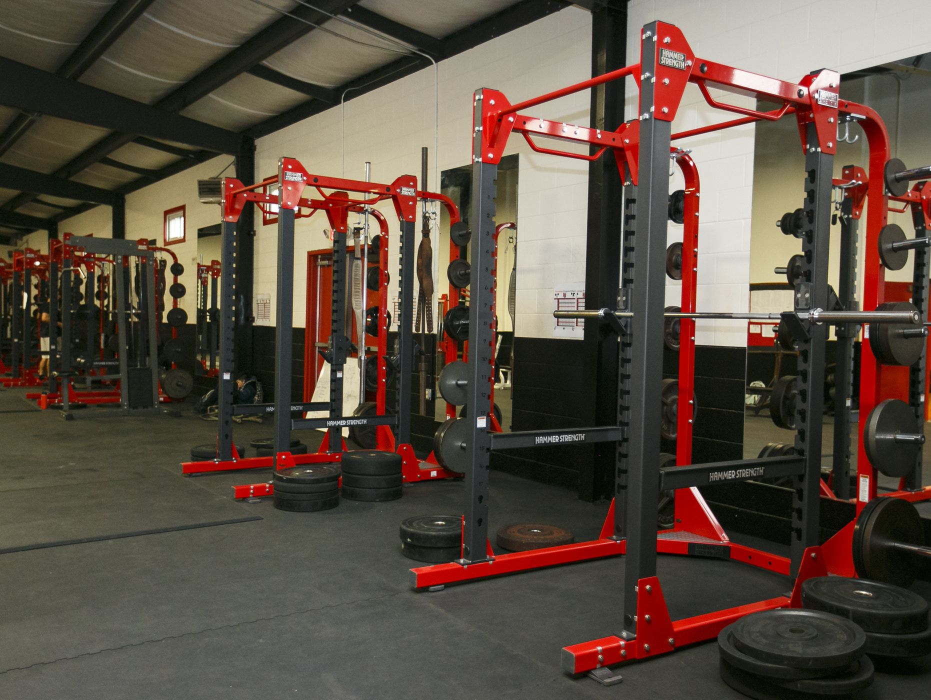 Squat racks in North Salem High School's newly remodeled weight room on Tuesday, Feb. 14, 2017. The facility includes new rubber floors, eight new weight lifting racks, four new spin bikes and new free weights.