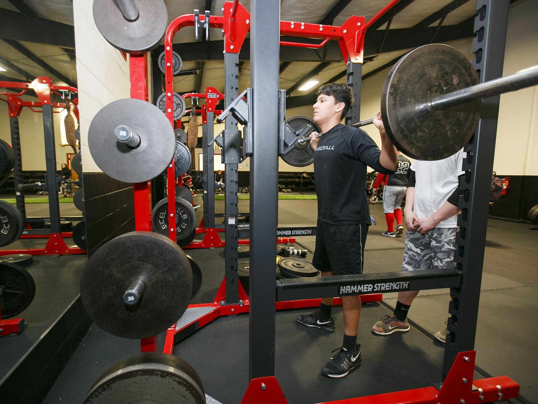 Sophomore Will Tsukamaki does squats in North Salem High School's newly remodeled weight room on Tuesday, Feb. 14, 2017. Tsukamaki and other students helped install the floor during the holiday break in December.