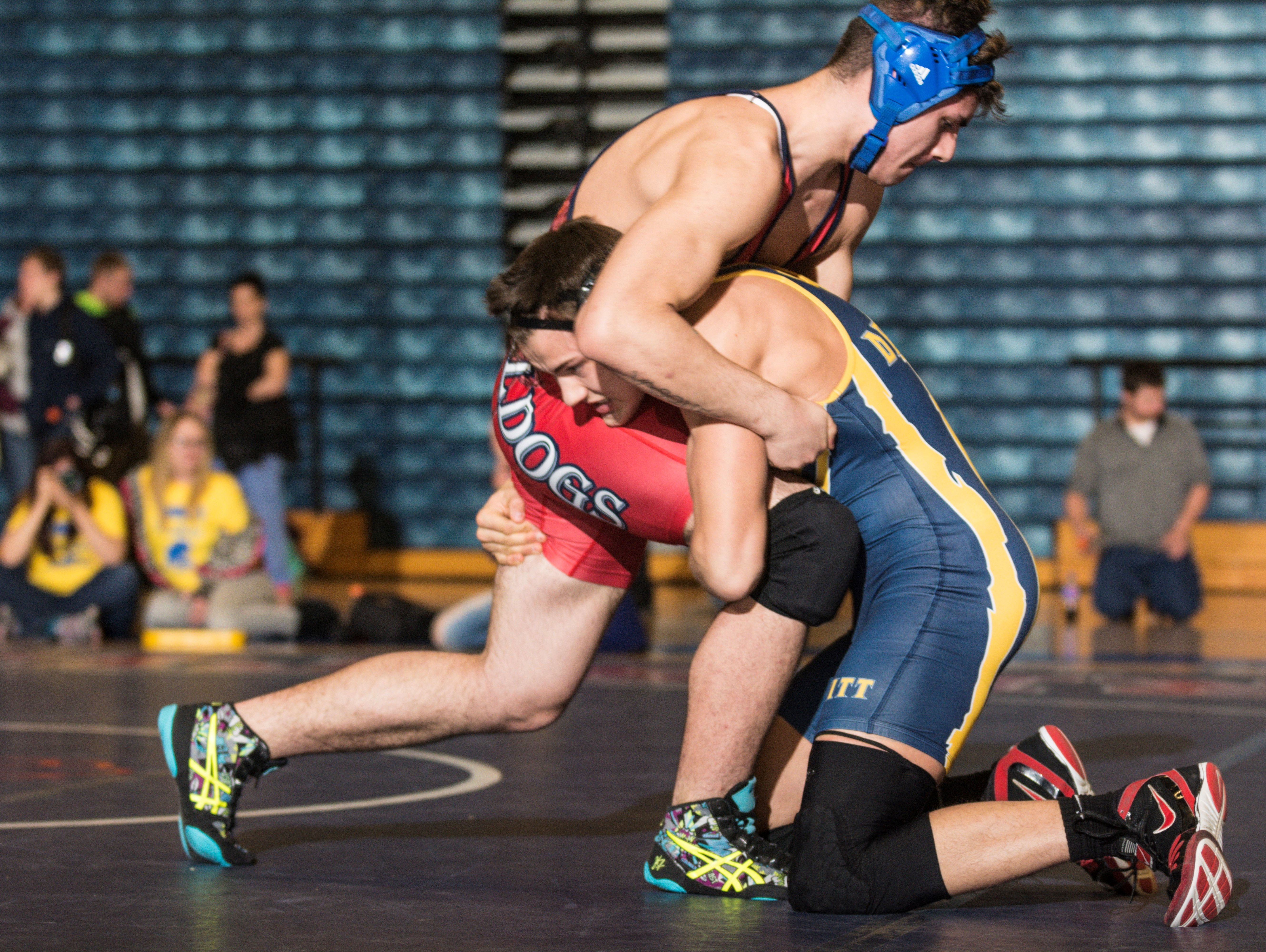 Lucas McFarland, right, of DeWitt gets in a single-leg of Devin Vasquez of Mason their 171lb. Division 2 regional final match Wednesday February 15, 2017 at Mason.