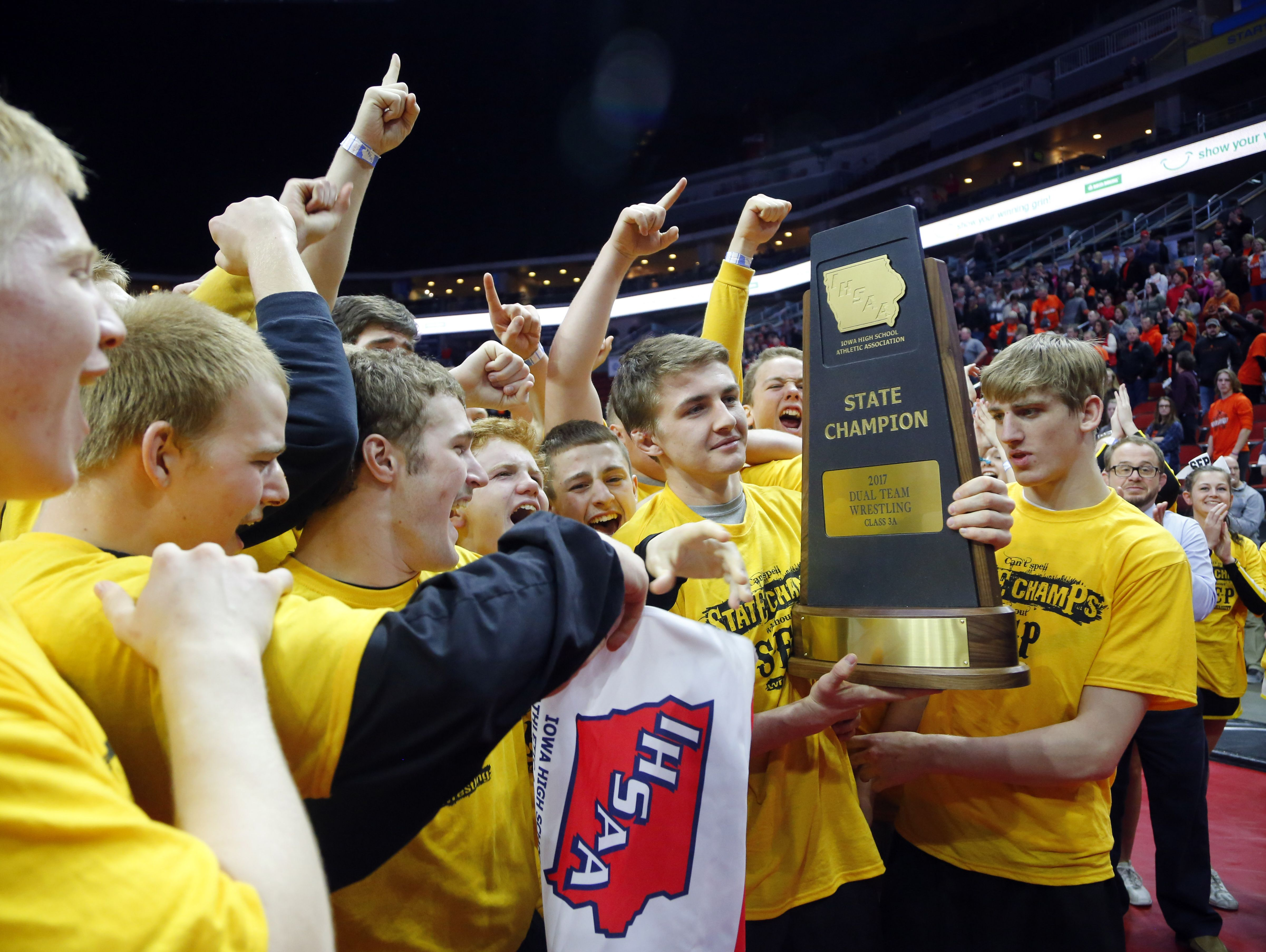 Southeast Polk celebrates after beating Fort Dodge to win the class 3A championship at the wrestling state team dual tournament Wednesday, Feb. 15, 2017.