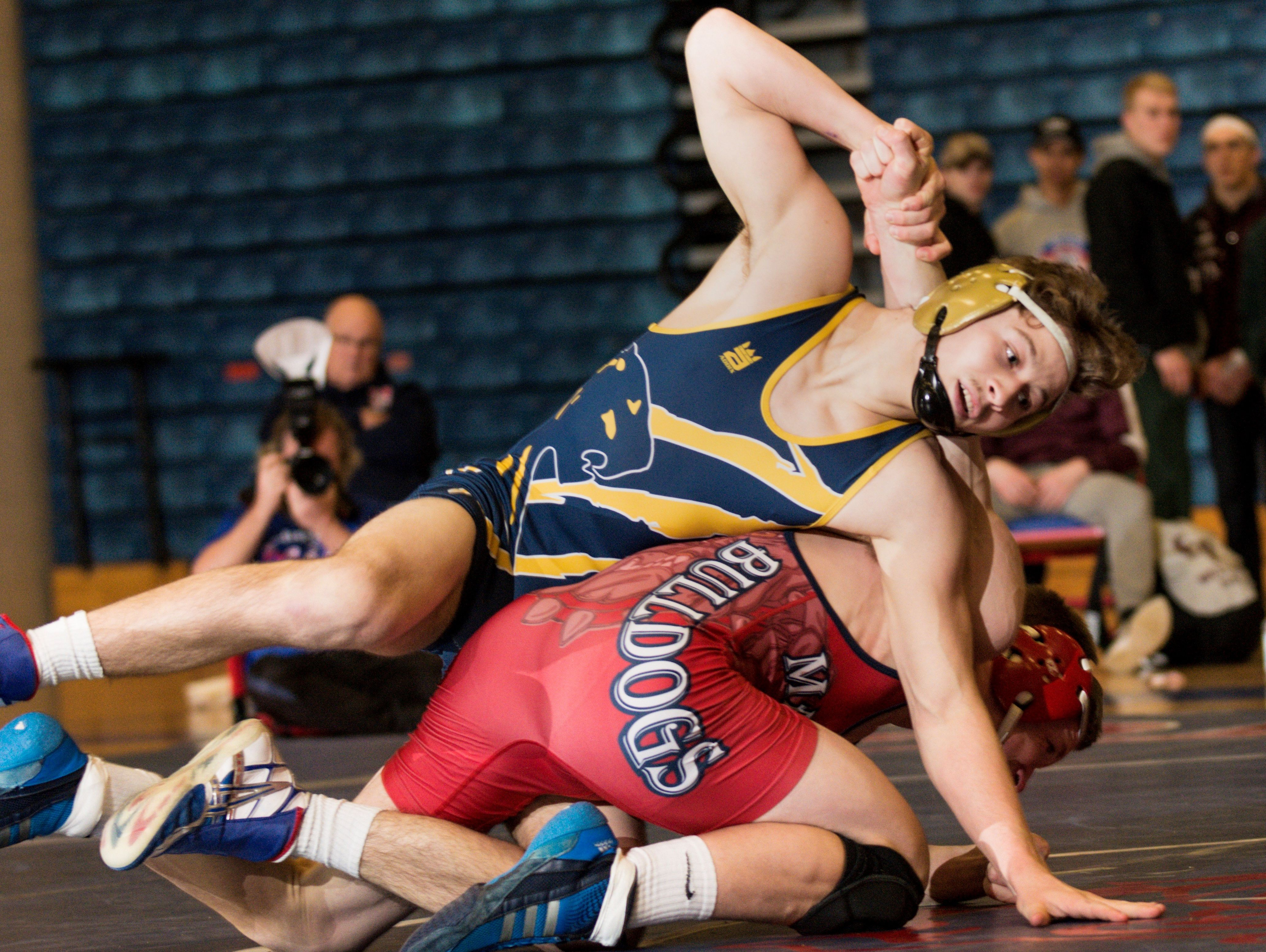 Sam York, left, of DeWitt attempts to turn Jared Surato of Mason during their 160lb. Division 2 regional final match Wednesday February 15, 2017 at Mason.