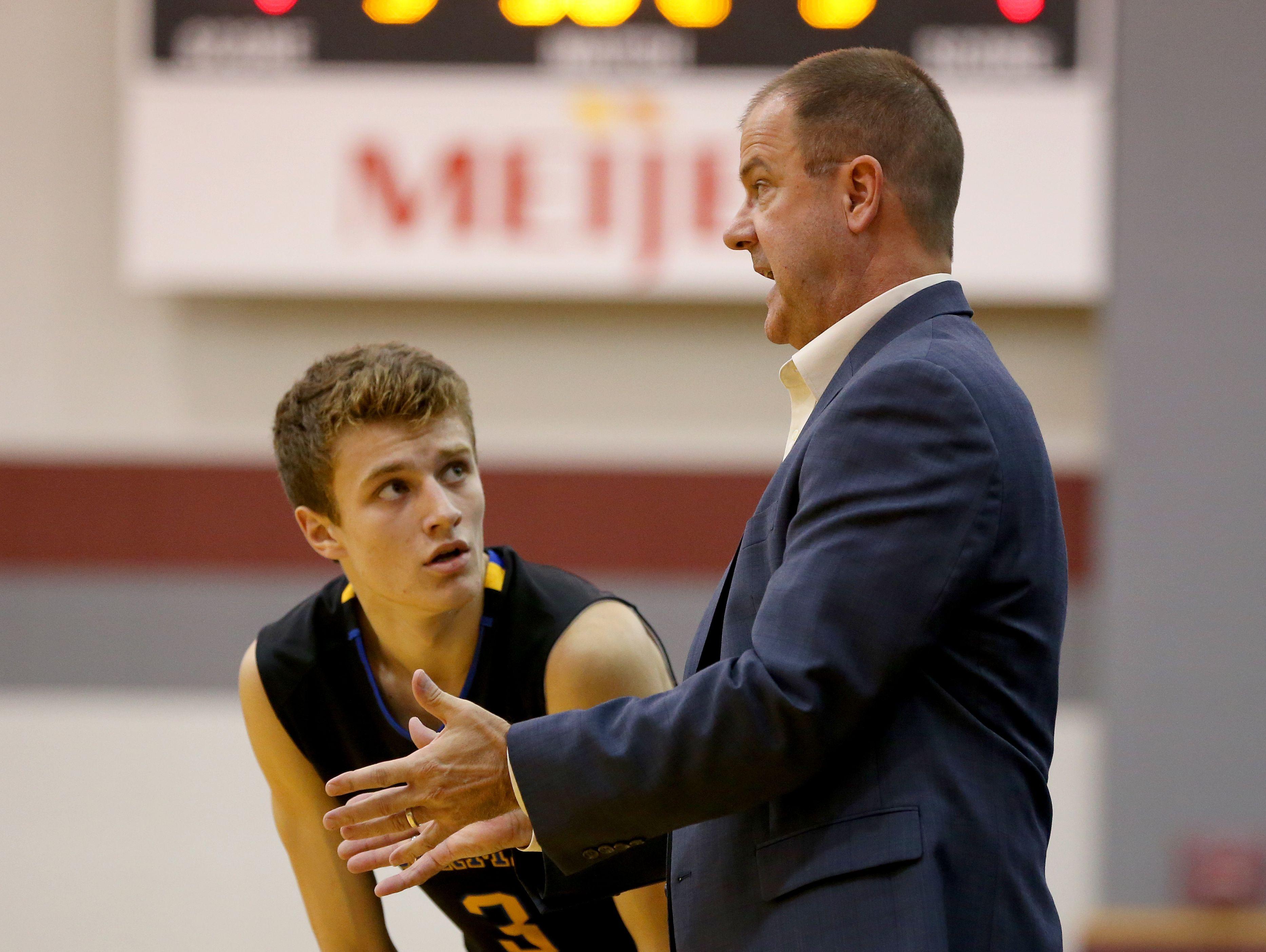 Carmel coach Scott Heady talks with Carmel's Cole Jenkins (3) on Dec. 4, 2015.