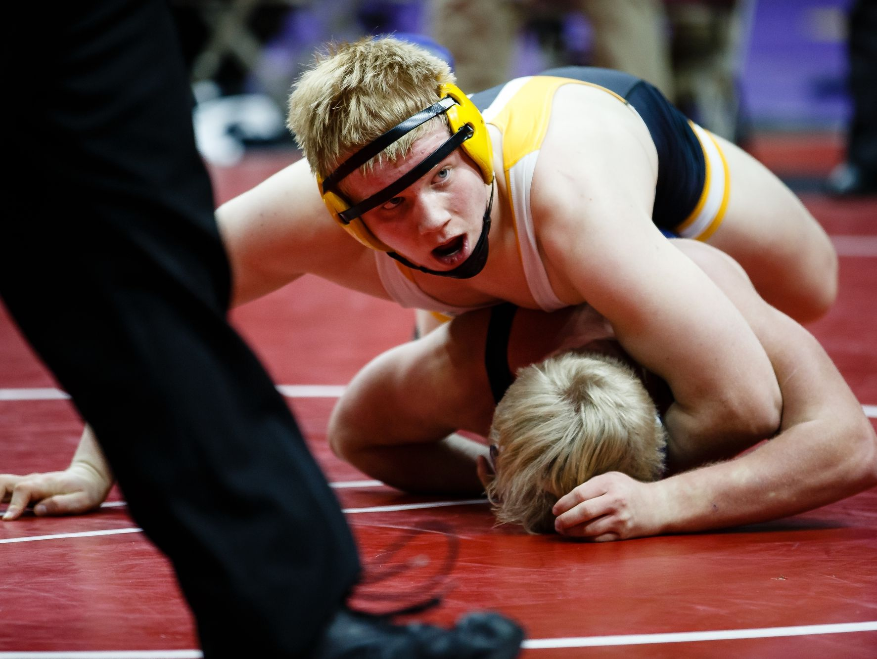 Gabe Christenson of Southeast Polk wrestles Cameron Mooore of Lewis Central during their 182-pound match Thursday at the state wrestling tournament.