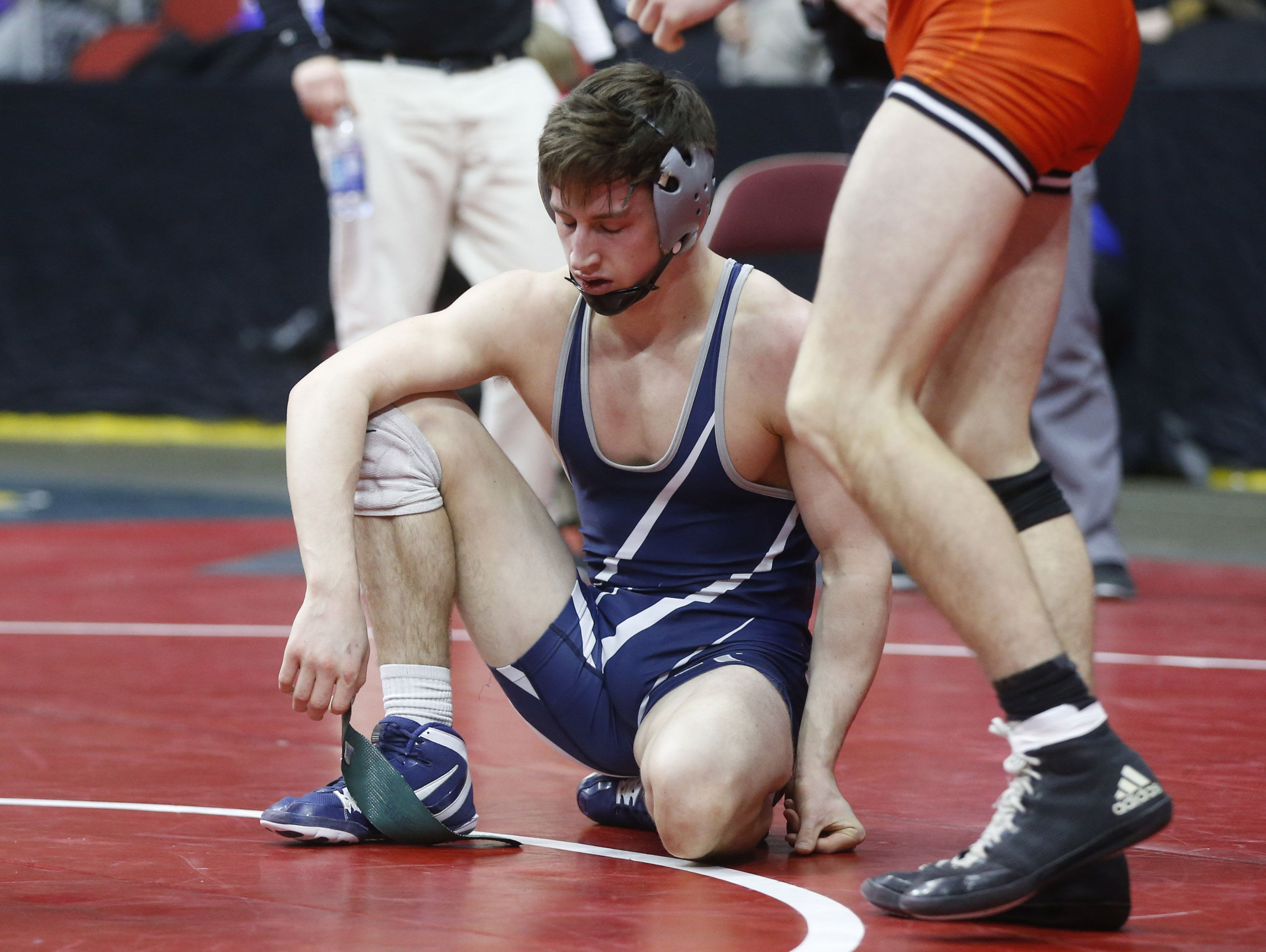 Cedar Rapids Xavier's Josh Gerke reacts after falling to Valley's Grant Stotts in their 145 pound match Thursday, Feb. 16, 2017 during the class 3A opening round at the 2017 State Wresting Tournament at Wells Fargo Arena in Des Moines.Thursday, Feb. 16, 2017 during the class 3A opening round at the 2017 State Wresting Tournament at Wells Fargo Arena in Des Moines.